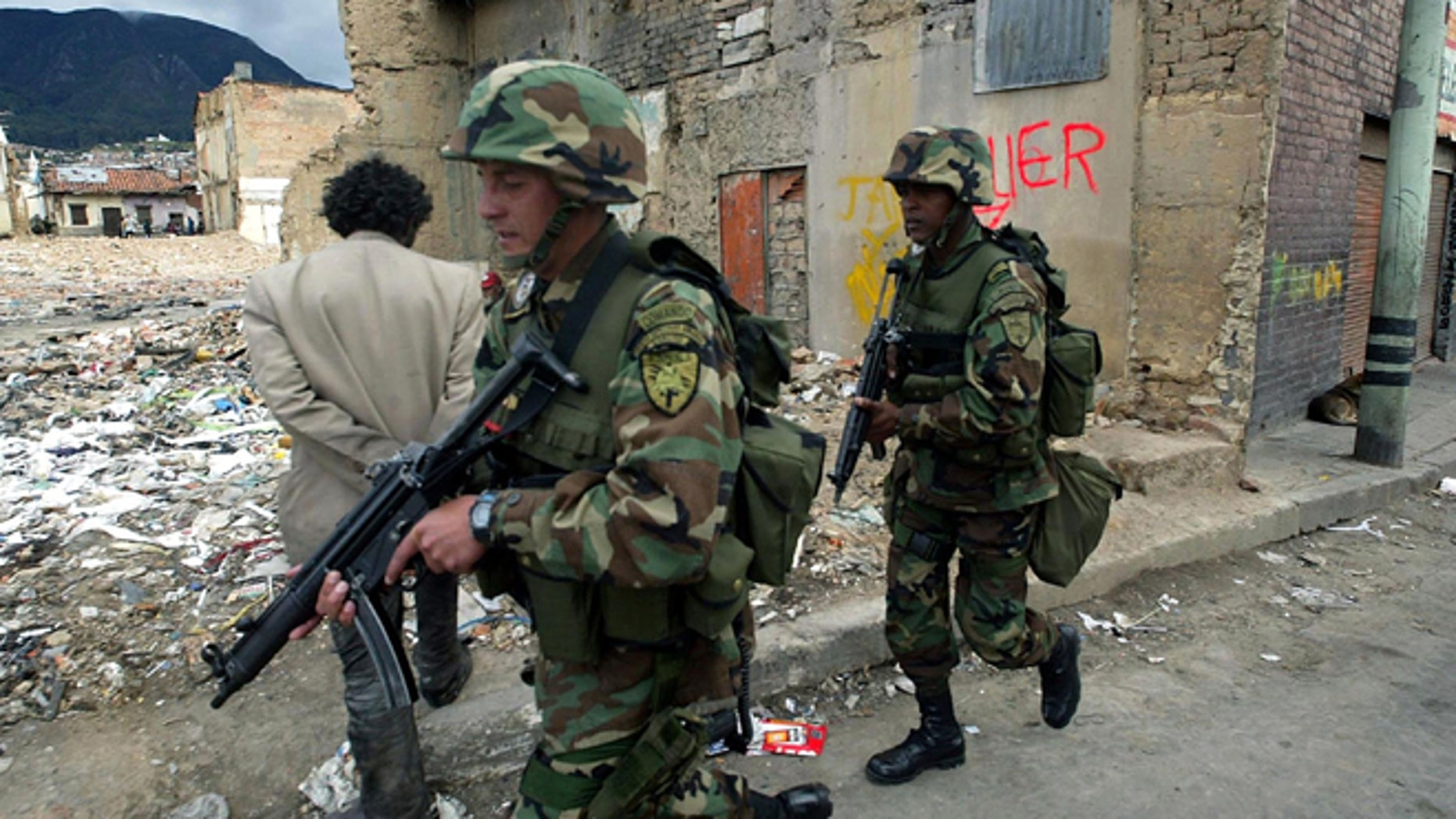 BOGOTA, COL- AUGUST 7:  Colombian soldiers patrol the area just blocks from parliament where suspected rebels targeted mortar rounds as Alvaro Uribe was sworn in as president August 7, 2002 in Bogota, Colombia.  Reports say at least14 people were killed and 69 wounded.  (Photo by Getty Images)