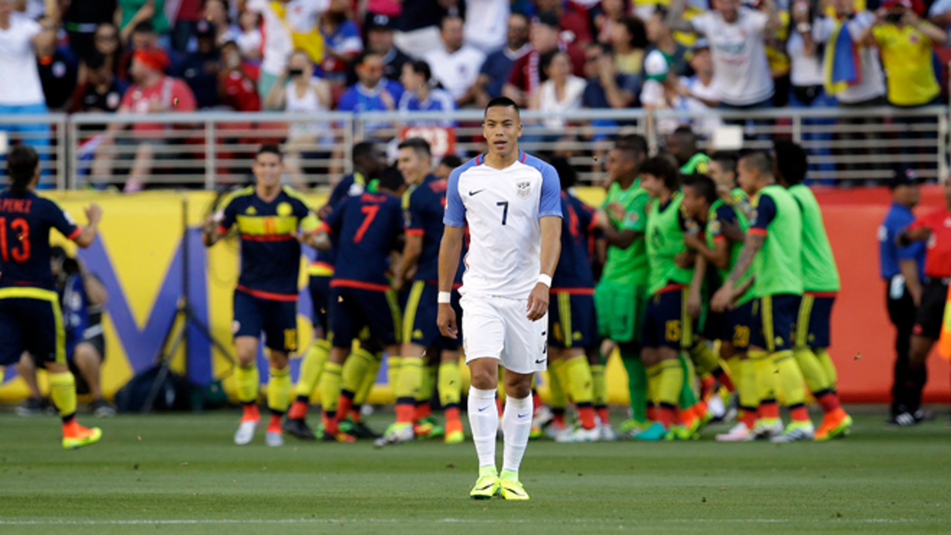 Colombia's players celebrate after scoring their first goal as United States' Bobby Wood, center, walks away during a Copa America Centenario Group A soccer match at the Levi's Stadium in Santa Clara, Calif., Friday, June 3, 2016. Colombia scored 2 first-half goals beating the US in the opener of the Copa America.(AP Photo/Marcio Jose Sanchez)