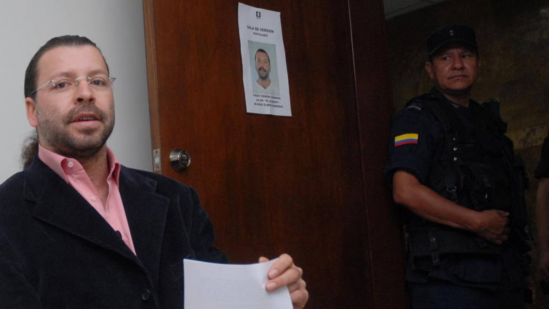 """FILE - In this June 5, 2007 file photo, former paramilitary leader Freddy Rendon sits inside a court before a hearing in Medellin, Colombia. Rendon, better known by his alias """"the German"""", was released from jail Thursday, July 30, 2015.  He is the most senior paramilitary commander to be freed after completing the maximum eight years stipulated in a law for former militia members who confess their war crimes to prosecutors and compensate victims. (AP Photo/ Luis Benavides, File)"""