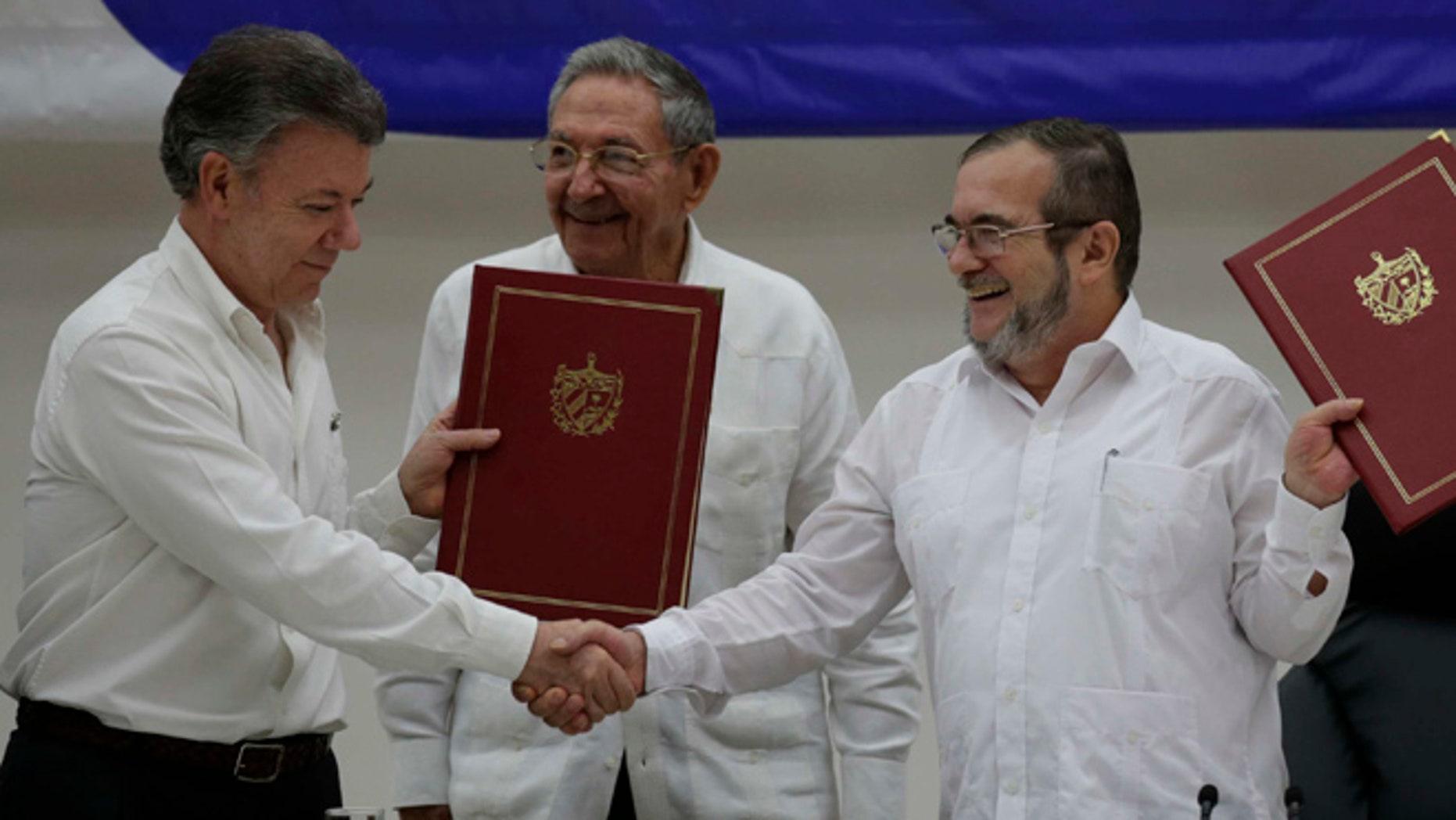 Colombian President Juan Manuel Santos, left, and FARC Commander  Timoleon Jimenez on June 23, 2016.