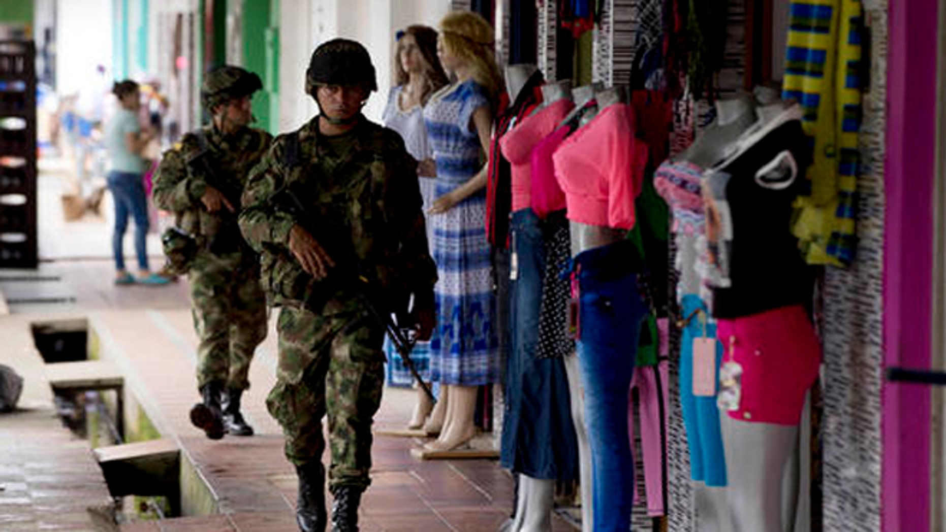Soldiers patrol in Puerto Rico, southern Colombia, on Sept. 21, 2016 .