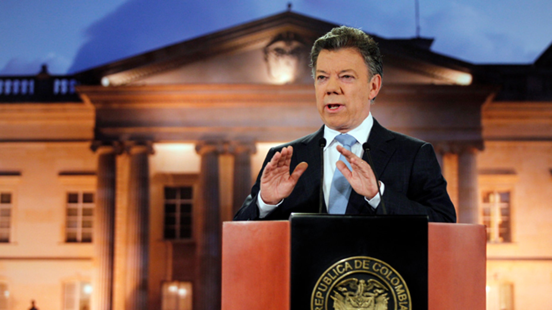 Colombia's President Juan Manuel Santos delivers a speech during a televised address to the nation at the presidential palace in Bogota, Colombia, Monday, Aug. 27, 2012. (AP Photo/Fernando Vergara)