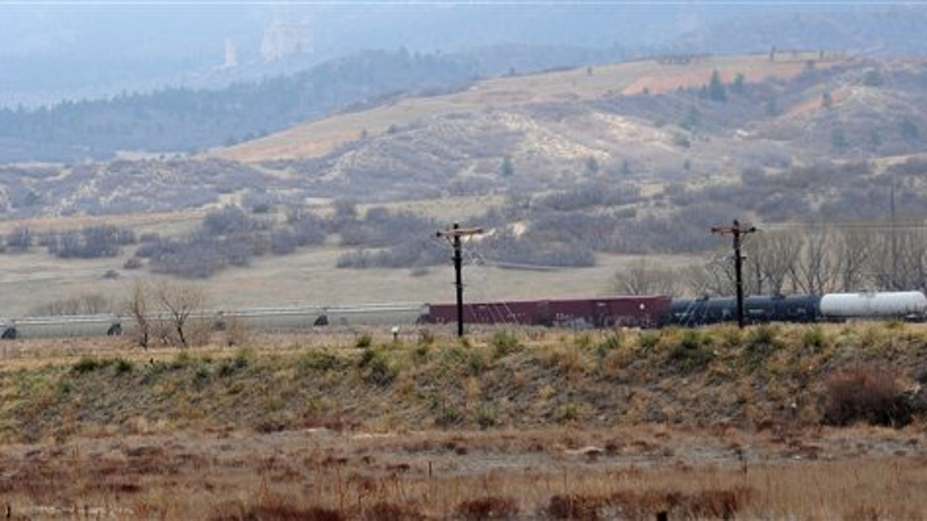 April 20: A train with a car leaking hydrochloric acid is parked on the tracks between Baptist Road and Monument, Colo. About 255 homes were evacuated.  (AP/The Gazette)
