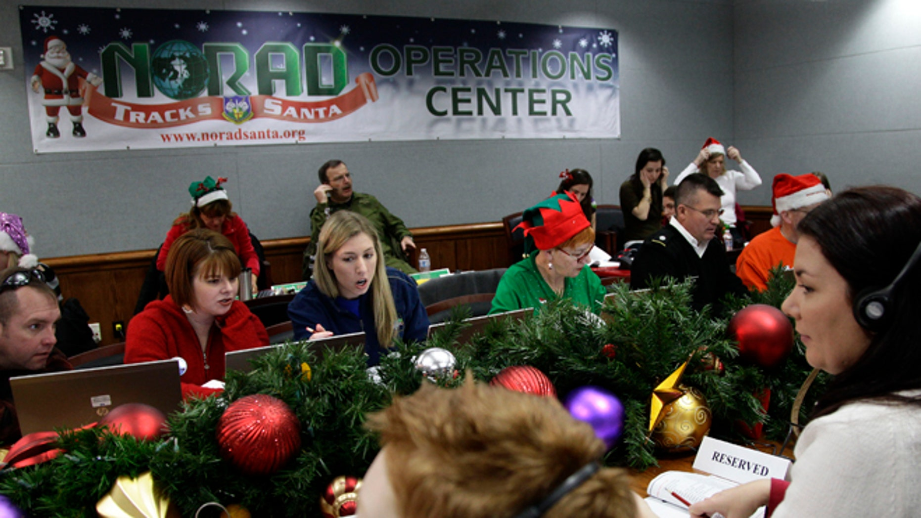 Dec. 24, 2012: Volunteers take phone calls from children asking where Santa is and when he will deliver presents to their house, during the annual NORAD Tracks Santa Operation, at the North American Aerospace Defense Command, or NORAD, at Peterson Air Force Base, in Colorado Springs, Colo.