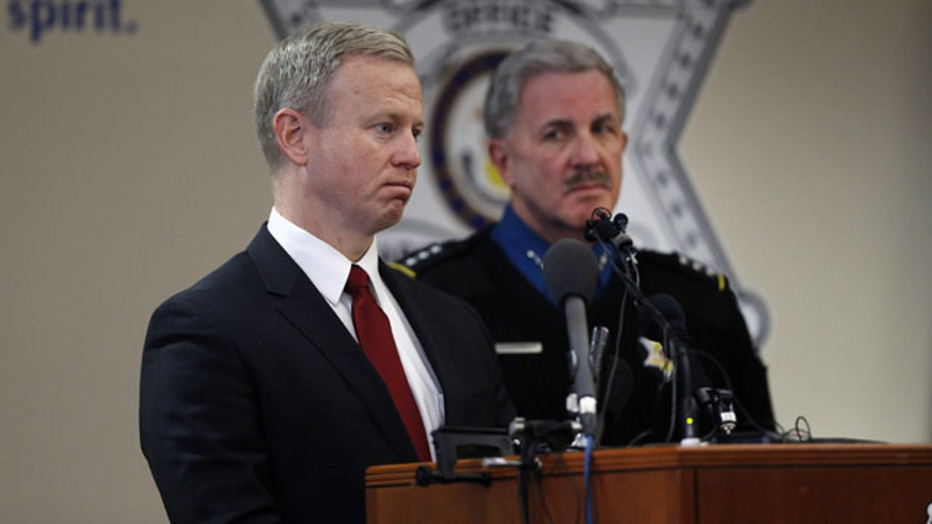 December 30, 2013: District Attorney for the 18th Judicial District George Brauchler, left, and Arapahoe County Sheriff Grayson Robinson take questions during a news conference at which they and other officials discussed the investigation into the Dec. 13 shooting at Arapahoe High School in Centennial, Colo. (AP Photo)