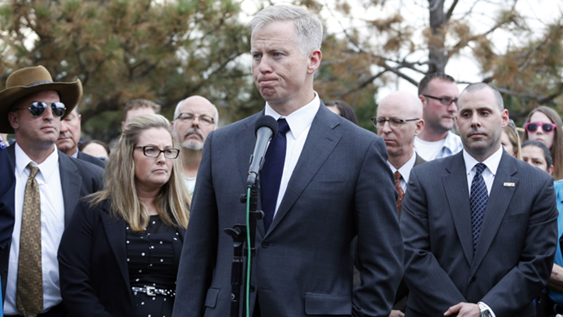 District Attorney George Brauchler speaks with members of the media following the reading of the jury's decision for Colorado theater shooter James Holmes, outside the Arapahoe County District Court. (AP Photo/Brennan Linsley)