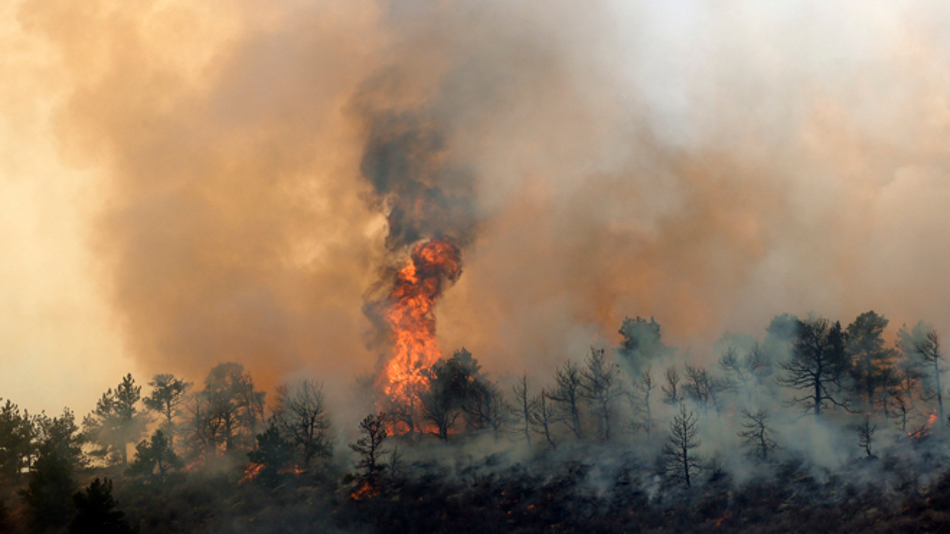 March 15, 2013: A wildfire burns out of control at Horsetooth Reservoir west of Fort Collins, Colo.