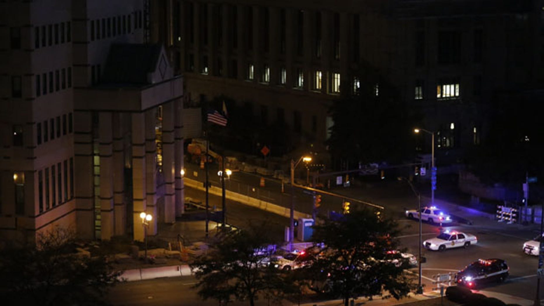 September 24, 2013: Dozens of police cars and fire trucks surround the Columbus Division of Police headquarters Tuesday after reports of an explosion. A Columbus Fire Department official says firefighters and police have not found any visual evidence of an explosion. No injuries have been reported. (AP Photo/The Columbus Dispatch, Jonathan Quilter)