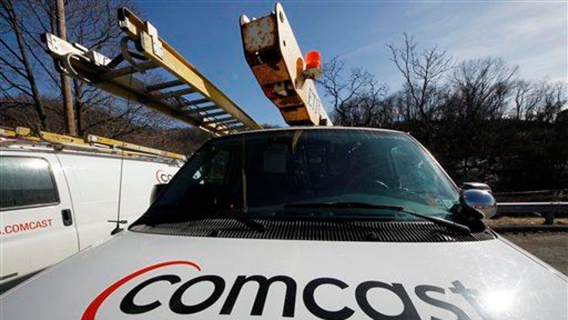 The Comcast logo is seen on a Comcast installation truck in Pittsburgh.