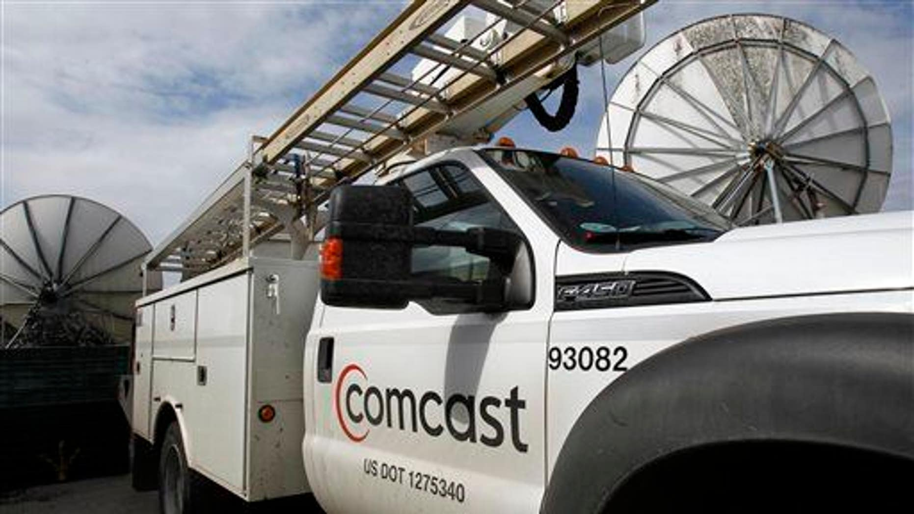 In this Thursday, April 25, 2013, photo, a Comcast truck is parked in Berlin, Vt.