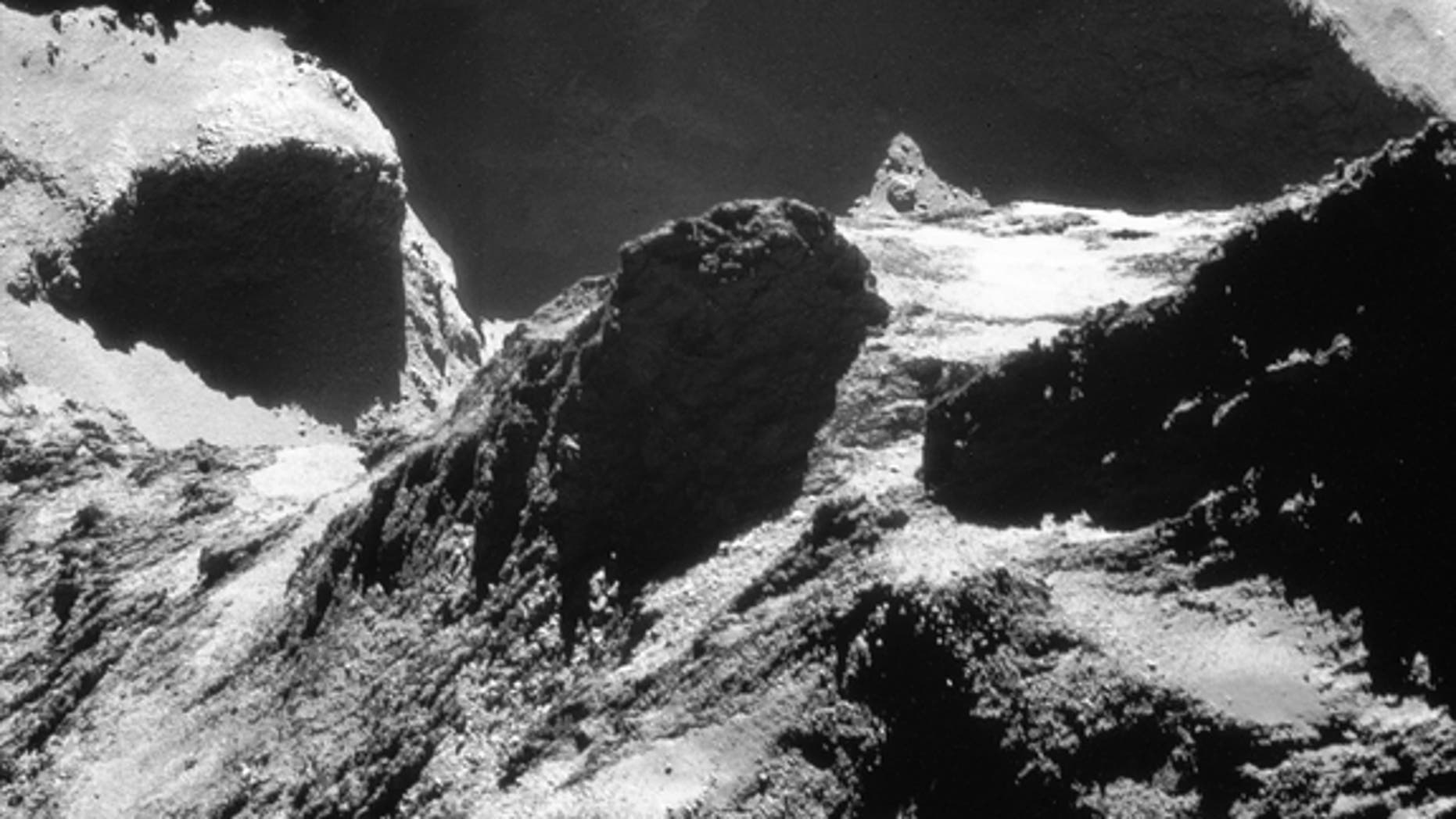 This single-frame Rosetta navigation camera image of Comet 67P/Churyumov-Gerasimenko was taken on October 19, 2014, at a distance of approximately 4.9 miles (7.9 km) from the comet's surface and released on May 28. The image looks across the ne