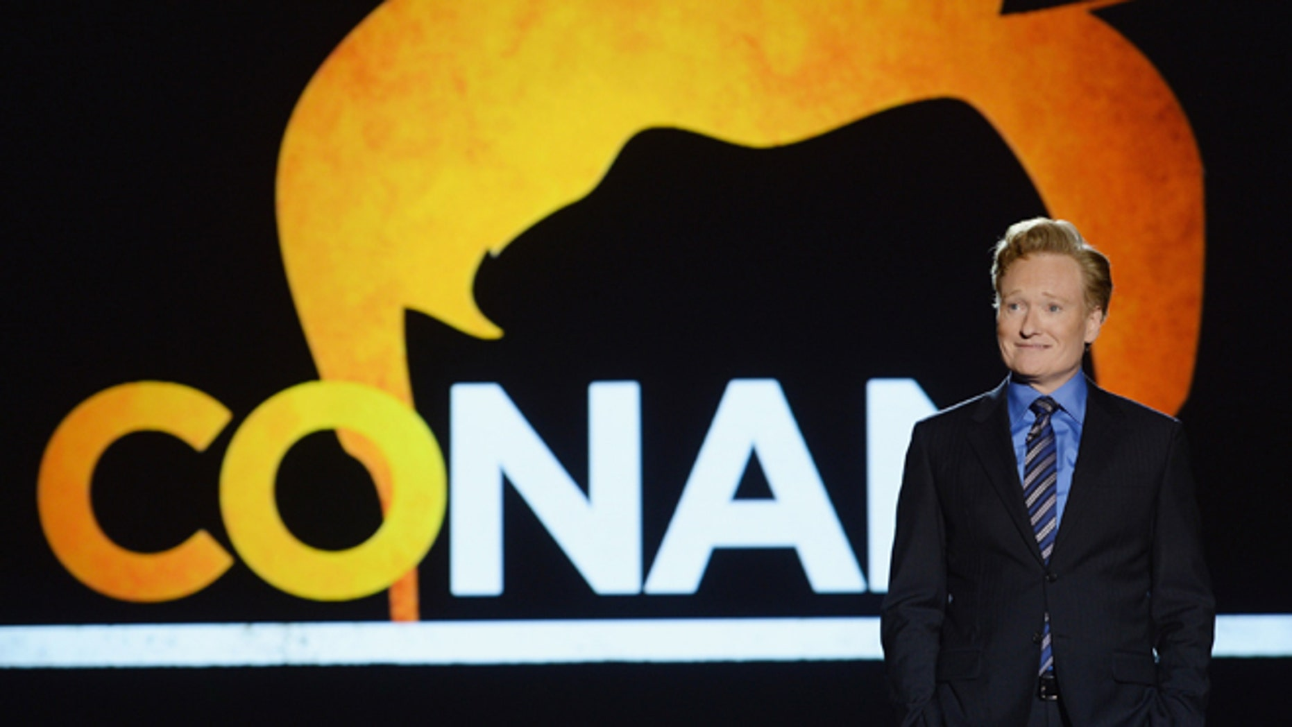 NEW YORK, NY - MAY 14: Conan O'Brien speaks onstage at the TBS / TNT Upfront 2014 at The Theater at Madison Square Garden on May 14, 2014 in New York City.  24674_002_1225.JPG  (Photo by Dimitrios Kambouris/Getty Images for Turner)
