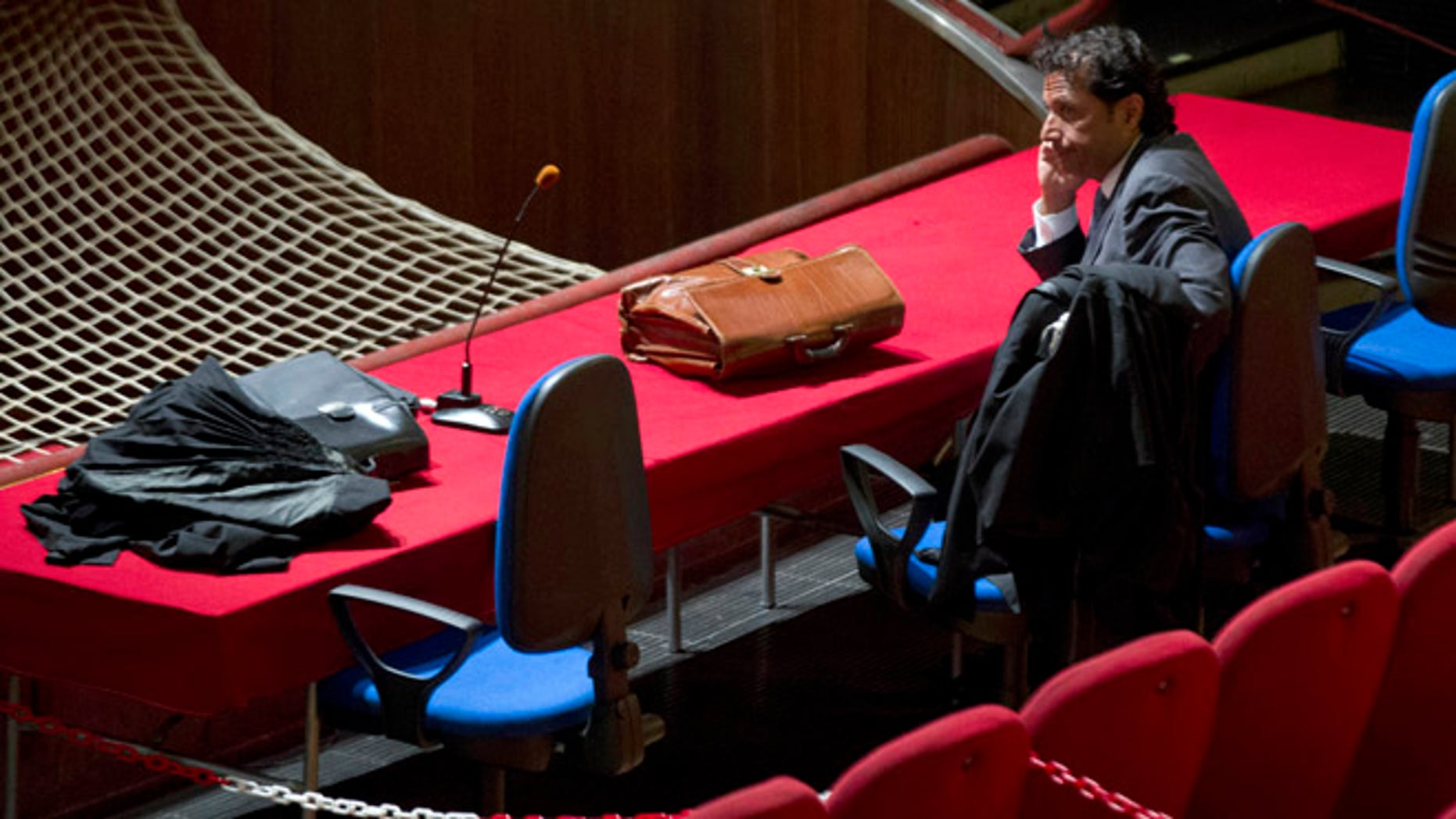 July 17, 2013: Captain Francesco Schettino waits for the start of his trial in the court room of the converted Teatro Moderno theater, in Grosseto, Italy.