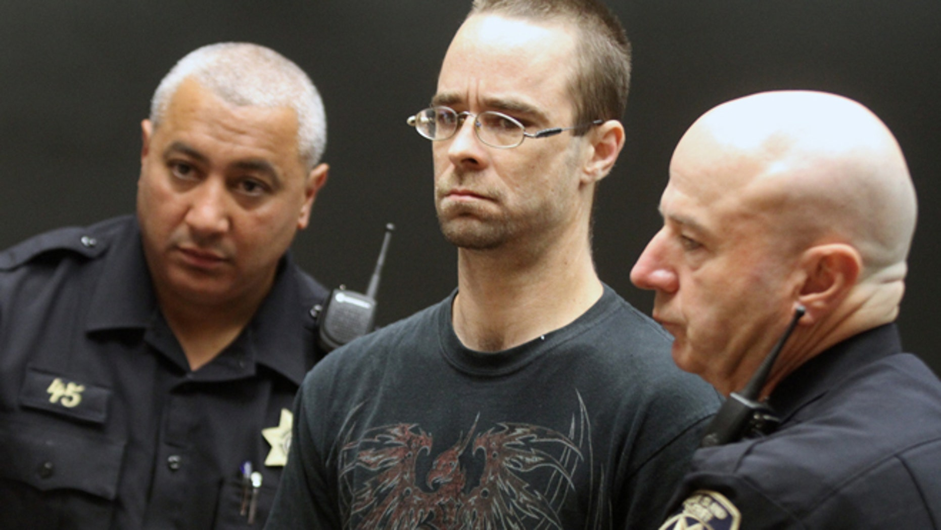 MAY 29: Steven Pietrowicz, Jr., center, of Burrillville, R.I., is arraigned on a murder charge in Providence District Court in Providence, R.I., for the murder of Domingo Ortiz of Worcester, Mass., Monday, June 1, 2015. Pietrowicz is one of two people facing murder charges in the death of Ortiz. The body of Ortiz was found Friday, May 29 under newly laid concrete beneath an outside deck of a house in Burrillville, R.I.,where Pietrowicz and Michelle Morin of Worcester, Mass. lived.
