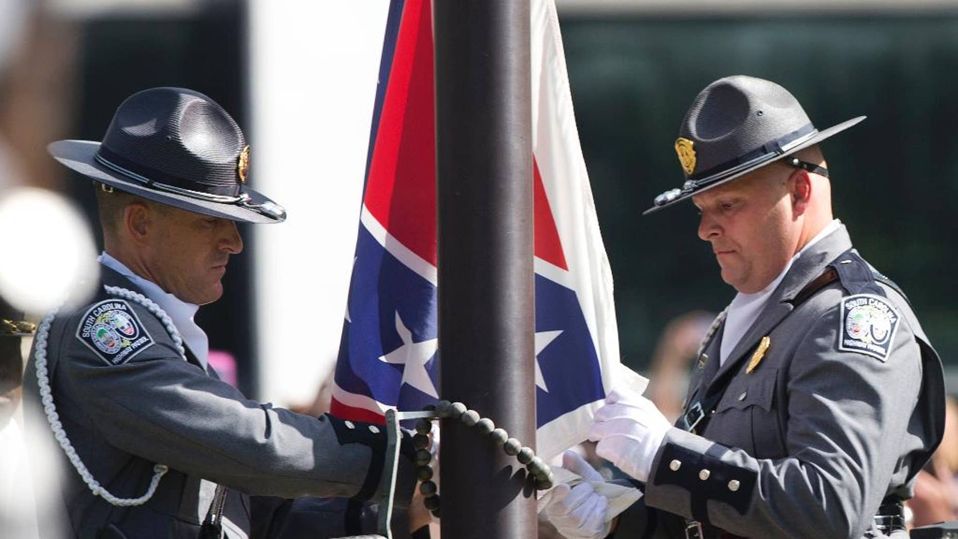 An honor guard from the South Carolina highway patrol lowers the Confederate battle flag as it is removed from the Capitol grounds in July 2015.