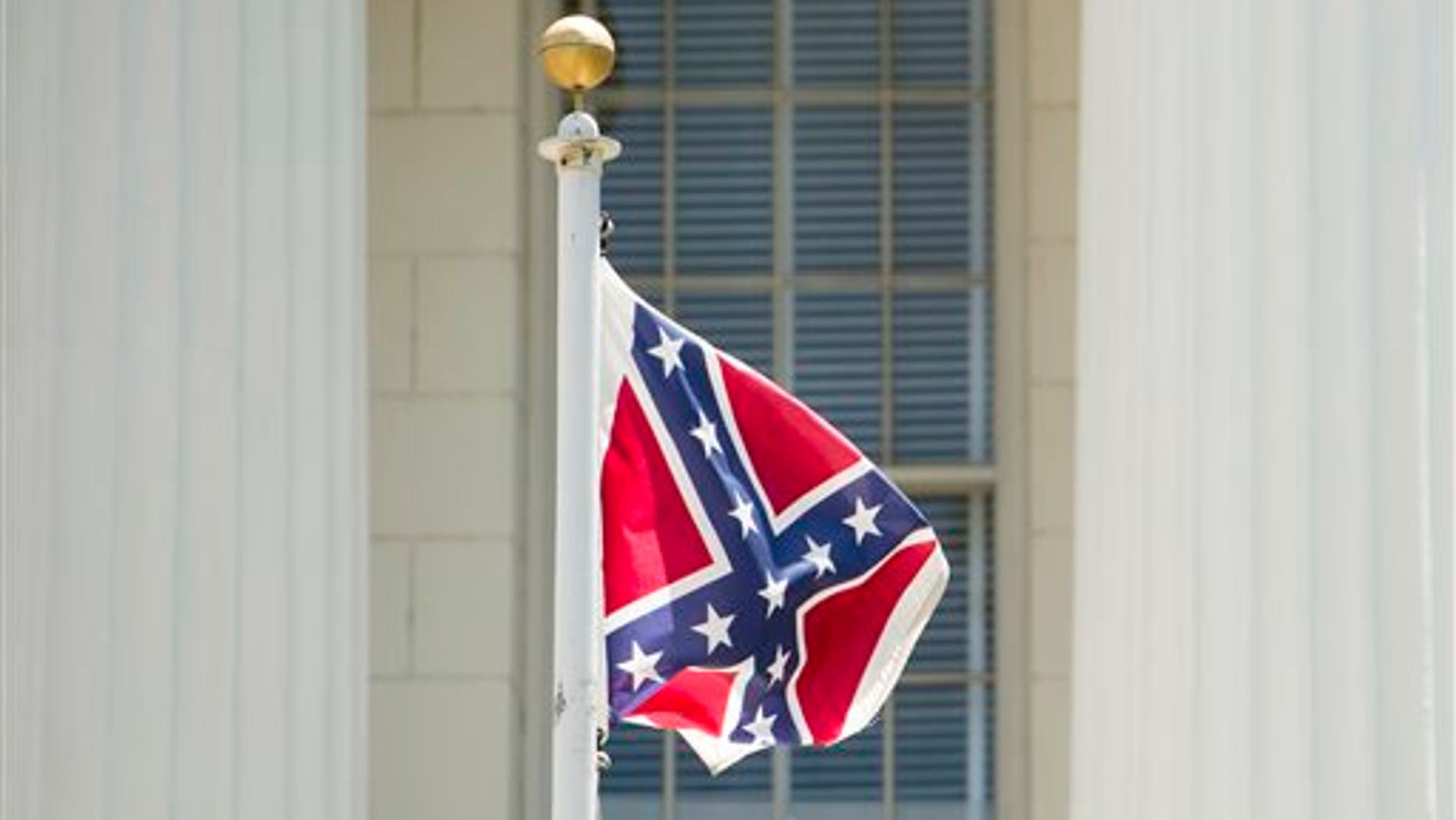 June 22: A Confederate flag flies on the grounds of the Alabama Capitol building in Montgomery, Ala.