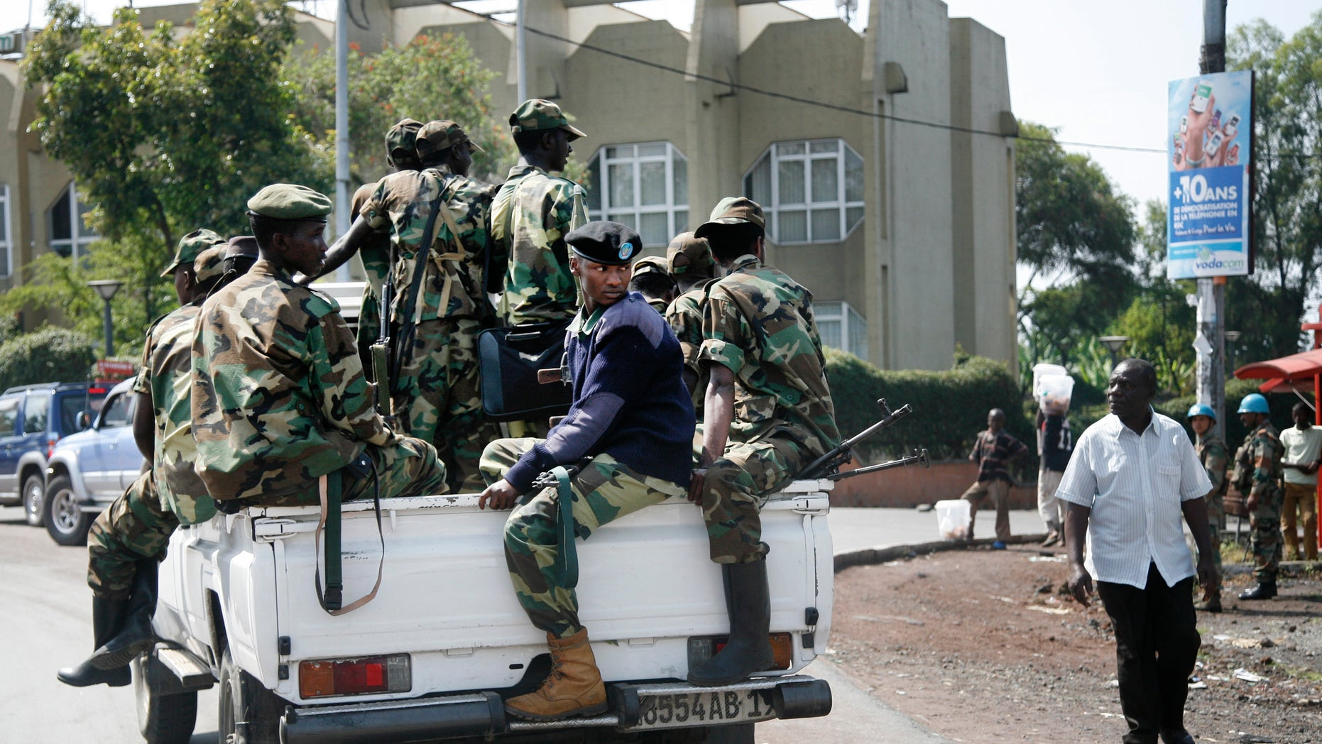 Nov. 26, 2012 -  Rebels patrol around Congo's Central Bank in Goma, eastern Congo.