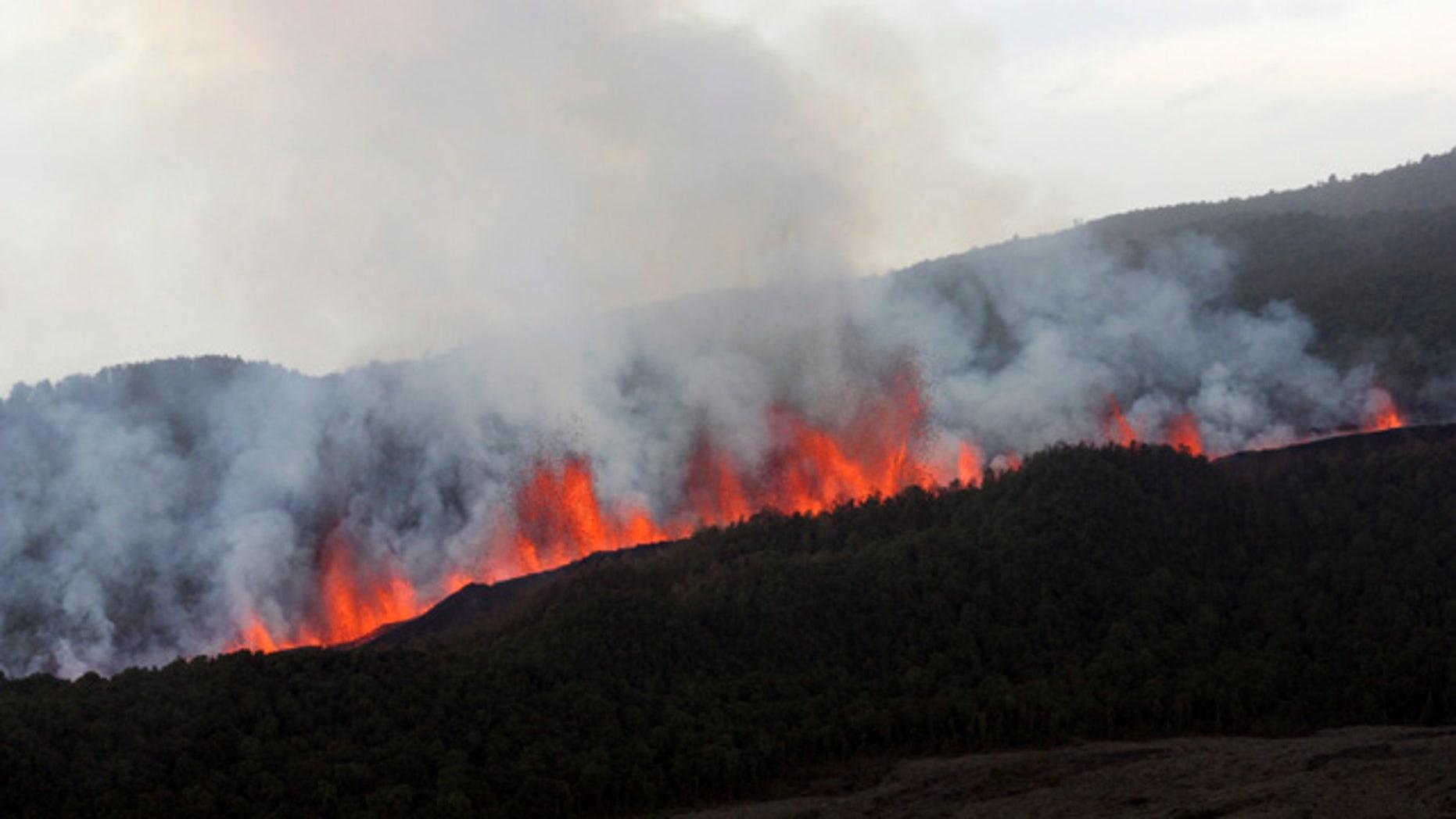 Lava flows down the slope of Nyamulagira volcano 25 miles northwest of Goma, North Kivu, Congo.