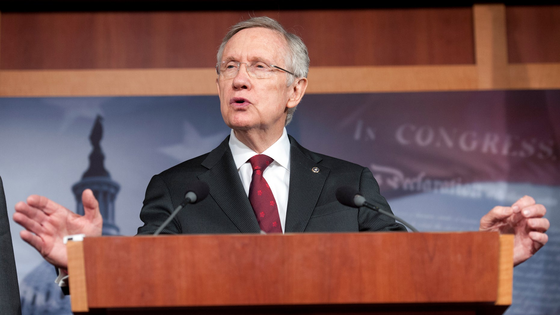 Senate Majority Leader Harry Reid, D-Nev., speaks with reporters about the federal budget on Capitol Hill in Washington, Thursday, March 14, 2013. (AP Photo/Cliff Owen)