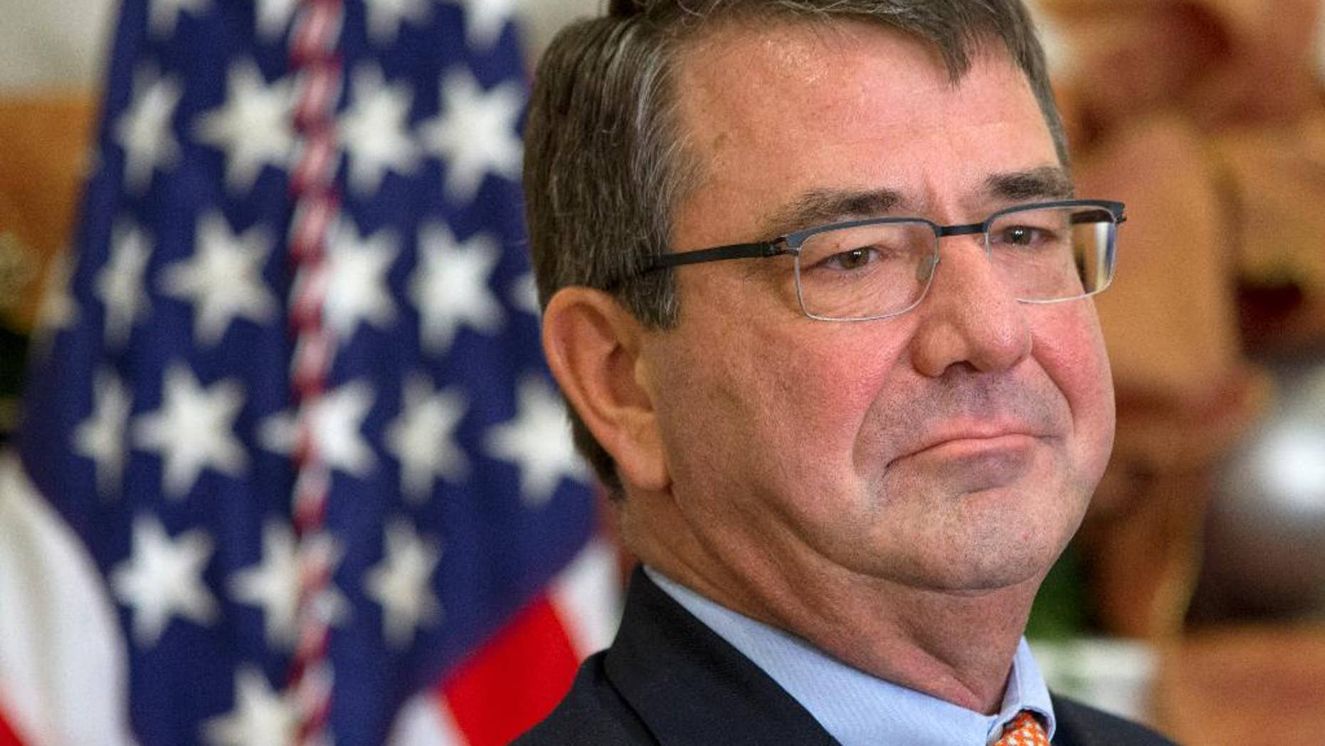 FILE - In this Dec. 5, 2014 file photo, Ashton Carter listens as President Barack Obama announces Carter as his nominee for defense secretary, in the Roosevelt Room of the White House in Washington. The Senate Armed Services Committee is holding a confirmation hearing next week to consider Ashton Carter to be the next secretary of defense. President Barack Obama nominated Carter to succeed Chuck Hagel, who resigned under pressure from Obama.(AP Photo/Jacquelyn Martin, File)