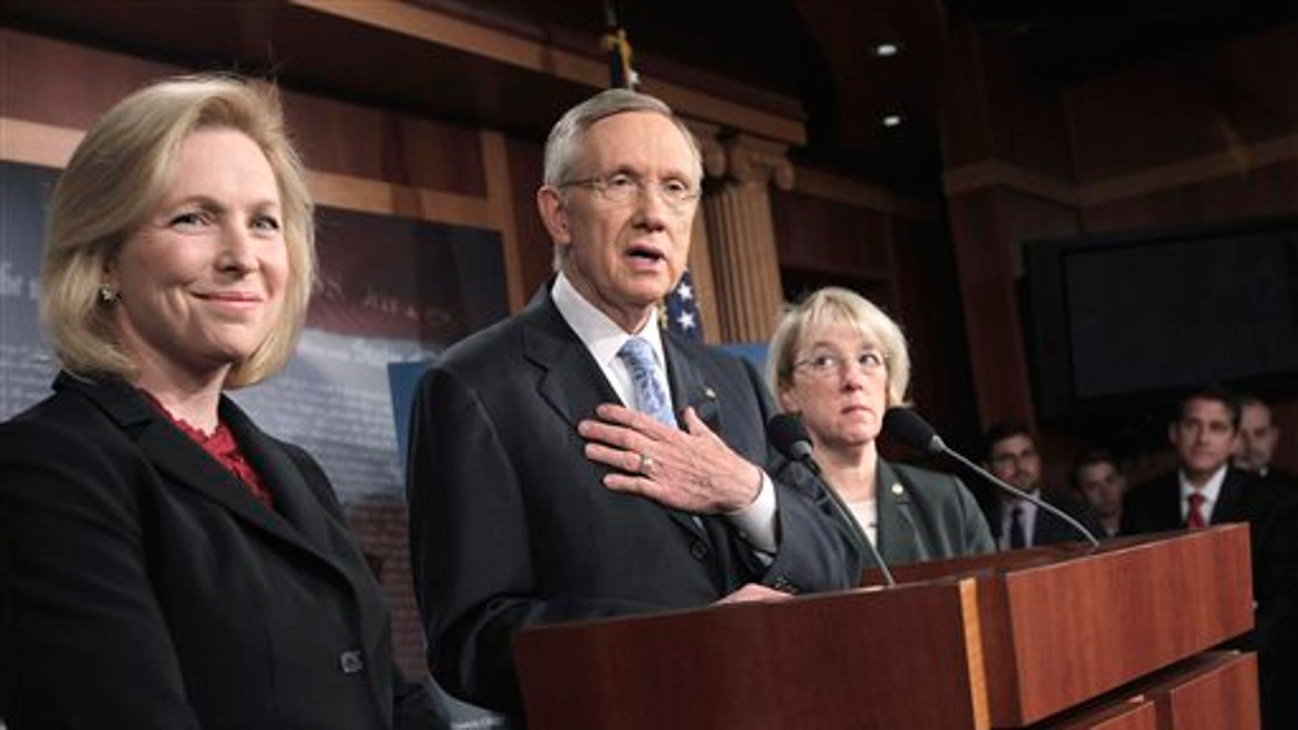 May 25: Senate Majority Leader Harry Reid of Nev., accompanied by Sen. Kirsten Gillibrand, D-N.Y., left, and Sen. Patty Murray, D-Wash., speaks to reporters on Capitol Hill in Washington. (AP)