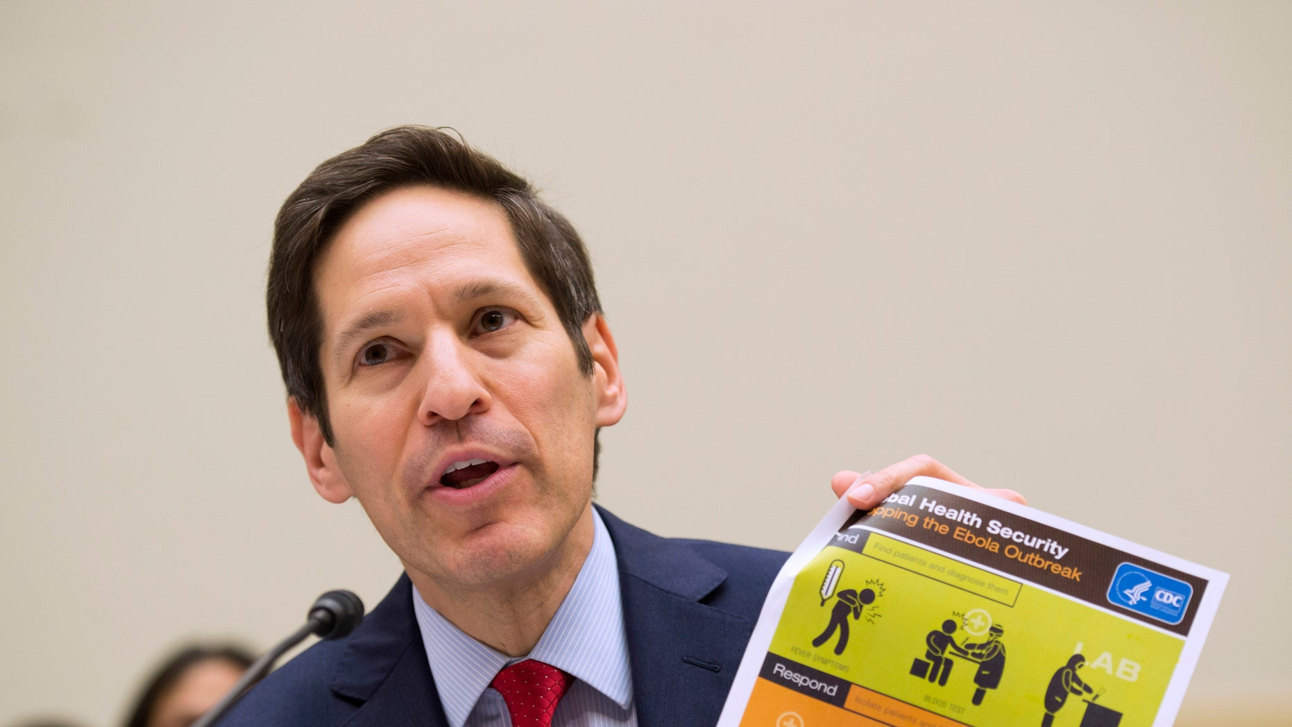 "Centers for Disease Control and Prevention (CDC) Director Dr. Tom Frieden testifies on Capitol Hill in Washington Thursday, Aug. 7, 2014, before the House subcommittee on Africa, Global Health, Global Human Rights, and International Organizations hearing on ""Combating the Ebola Threat."" (AP Photo/Molly Riley)"