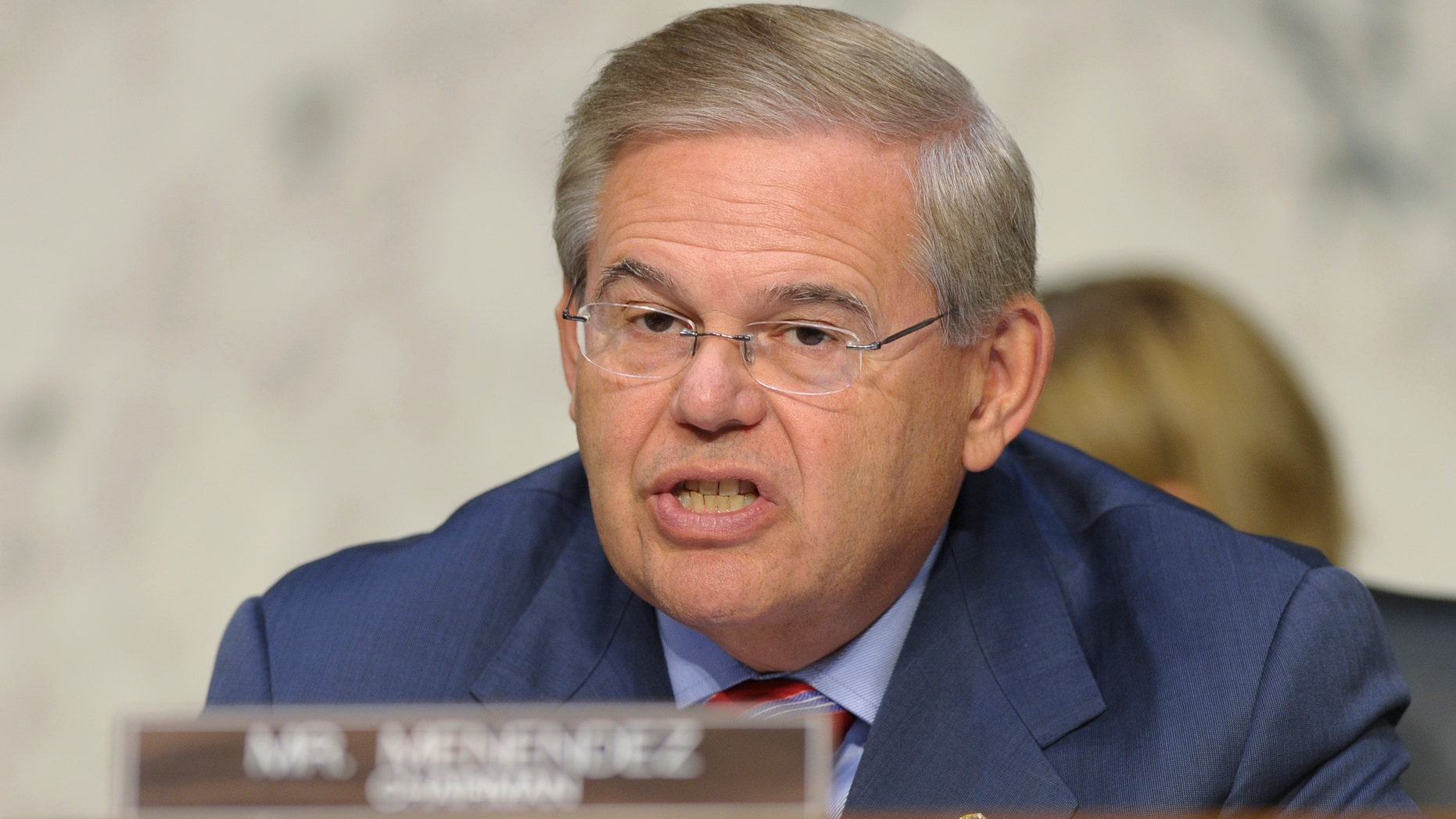 FILE - In this Sept. 4, 2013, file photo, Sen. Robert Menendez, D-N.J. speaks at Capitol Hill in Washington. Key Democratic and Republican senators are crafting legislation to reinstate the full force of Iran sanctions and impose new ones if Tehran doesnât make good on its pledge to roll back its nuclear program, brushing aside the Obama administrationâs fears about upending its diplomatic momentum. Menendez and Sen. Mark Kirk, R-Ill., hope to have the bill ready for other lawmakers to consider when the Senate returns Dec. 9 from its two-week recess, according to legislative aides. (AP Photo/Susan Walsh)