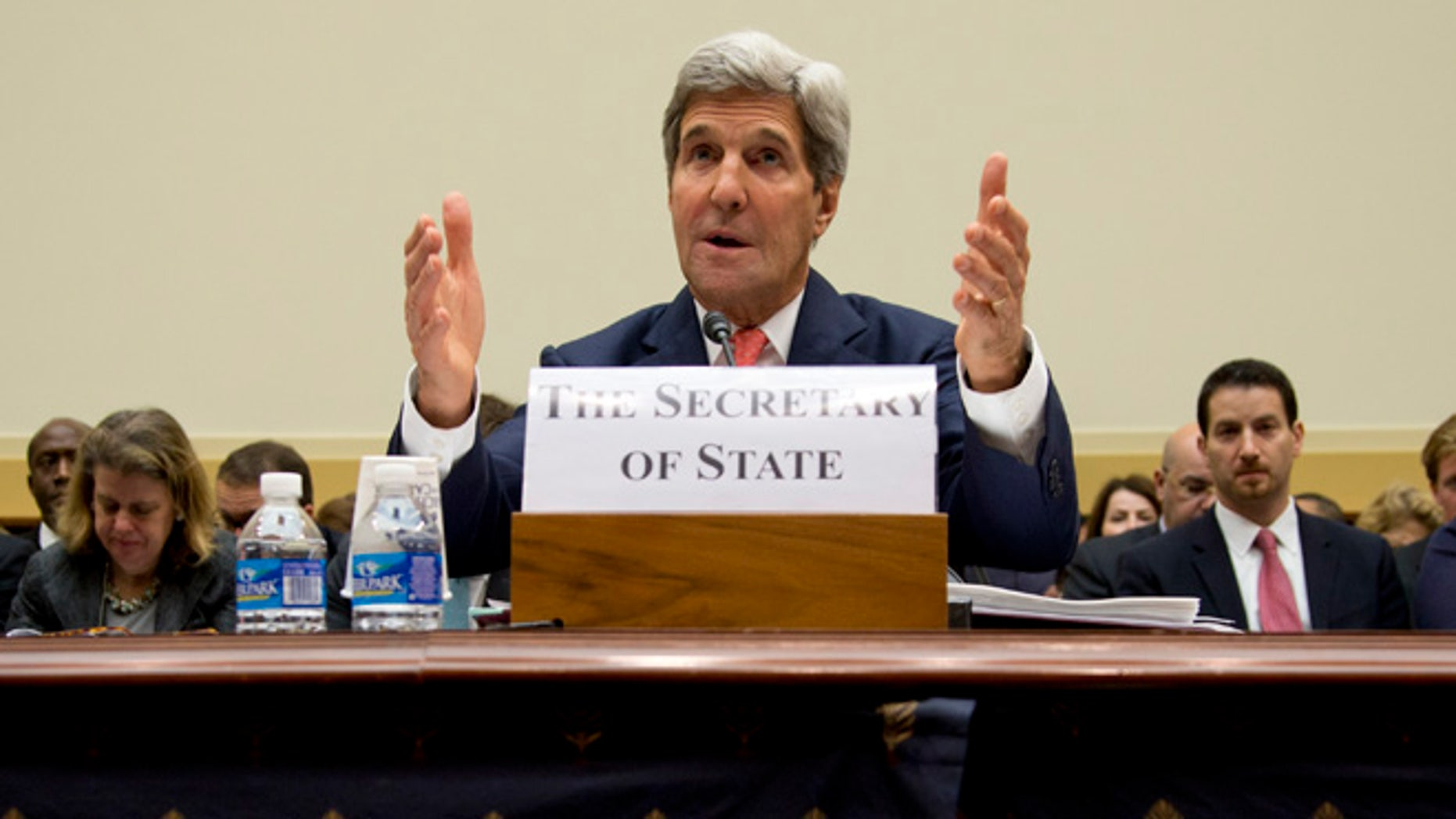 In this Thursday, Sept. 18, 2014 photo, Secretary of State John Kerry testifies on Capitol Hill in Washington during a House Foreign Affairs Committee hearing.