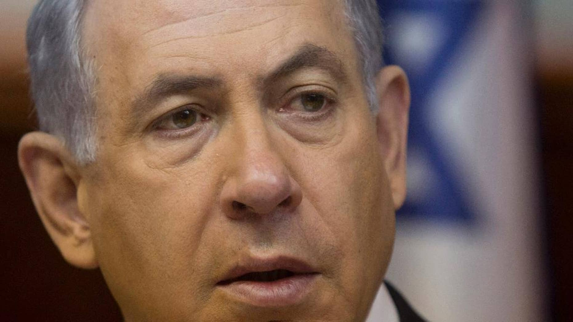 FILE - In this Feb. 8, 2015 file-pool photo, Israeli Prime Minister Benjamin Netanyahu attends the weekly cabinet meeting in his Jerusalem office. A group of almost two dozen liberal Democrats have signed a letter to House Speaker John Boehner asking him to postpone Israeli Prime Minister Benjamin Netanyahu's address to a joint meeting of Congress next month. (AP Photo/Sebastian Scheiner, File-Pool)