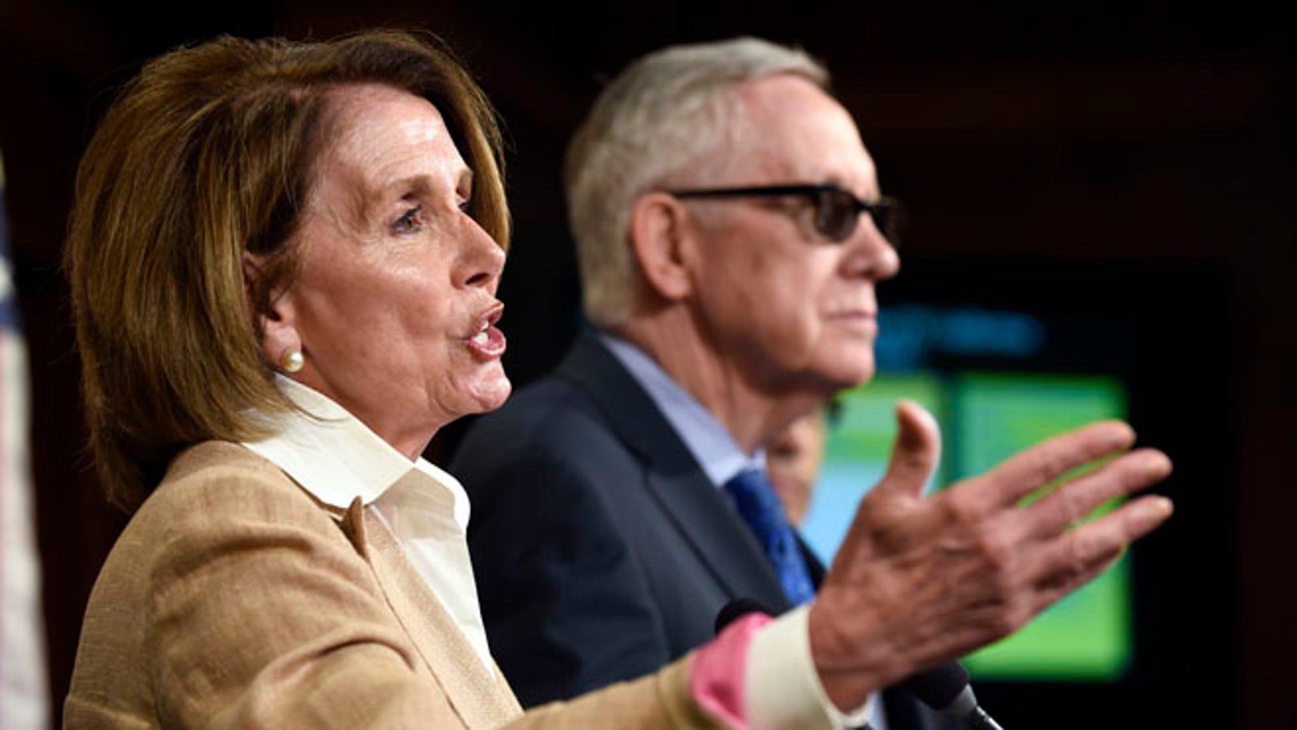FILE: June 25, 2015: House Minority Leader Nancy Pelosi of Calif., and Senate Minority Leader Harry Reid, of Nev., on Capitol Hill, Wash., D.C.