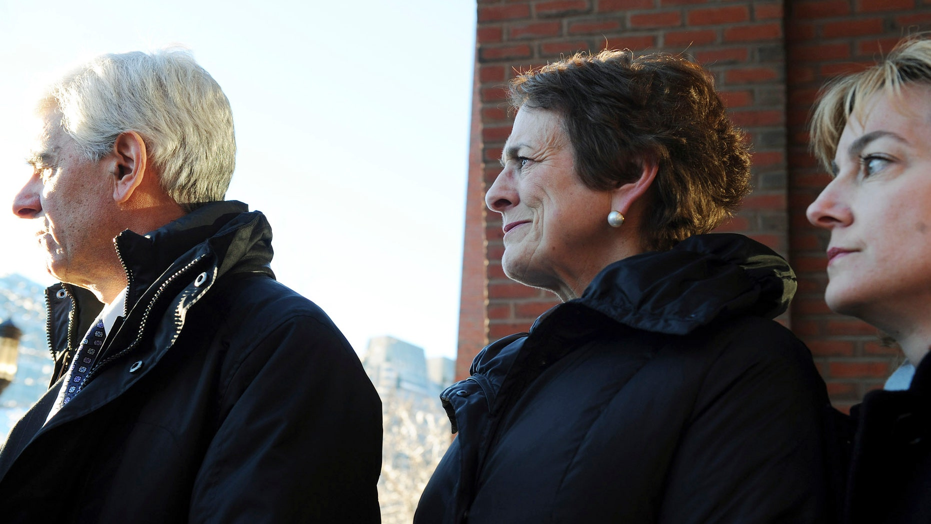Jan. 13: Patrice Tierney, center, wife of state Rep. John Tierney, is flanked by her lawer Donald Stern. left, and her spokesperson Jennifer Flagg, right, as she leaves federal court in Boston. Patrice Tierney was sentenced to 30 days in prison for tax charges related to helping her brother conceal income from an illegal offshore gambling business.
