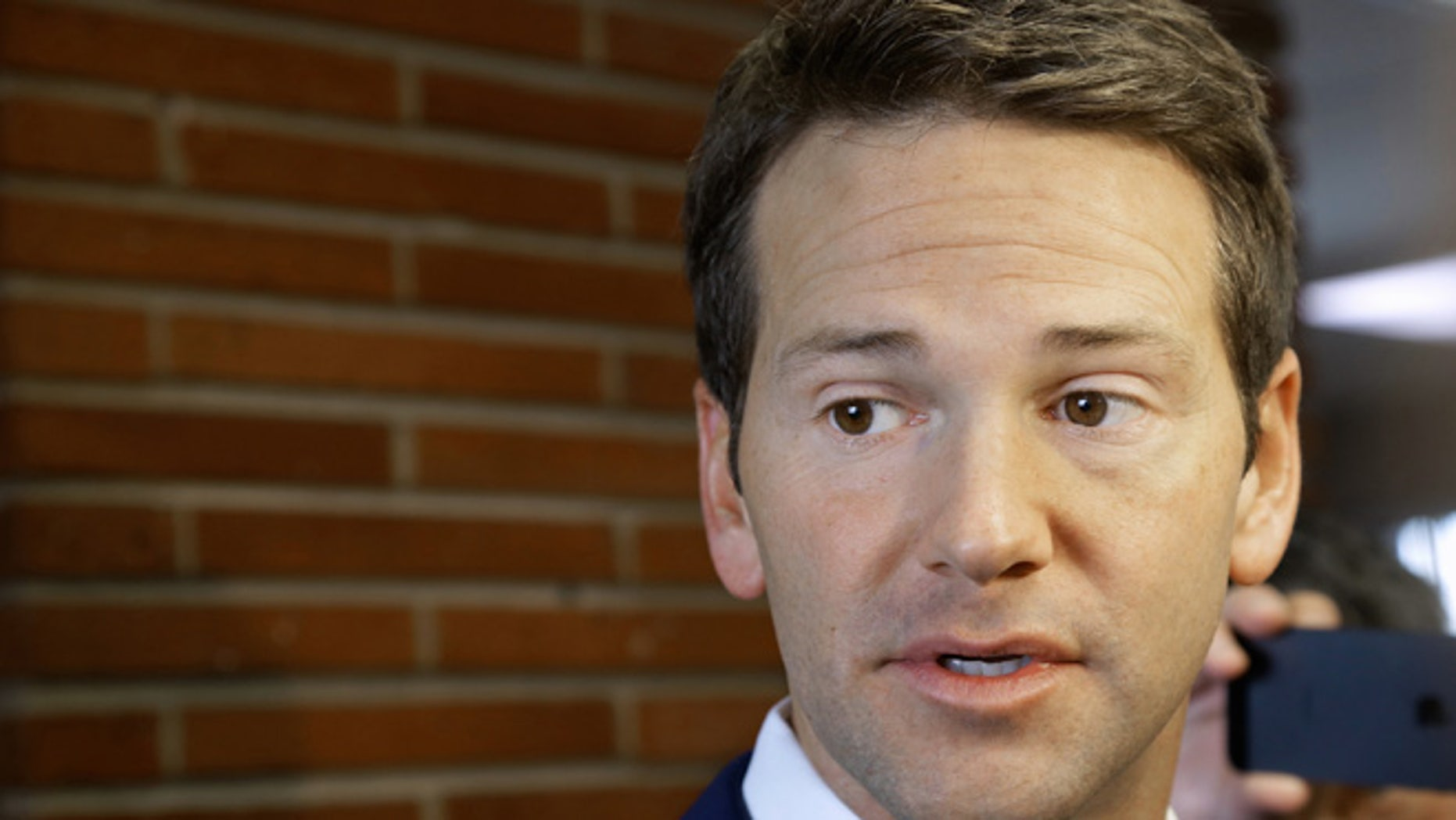 Feb. 6, 2015: Then-Rep. Aaron Schock, R-Ill. speaks to reporters in Peoria Ill.