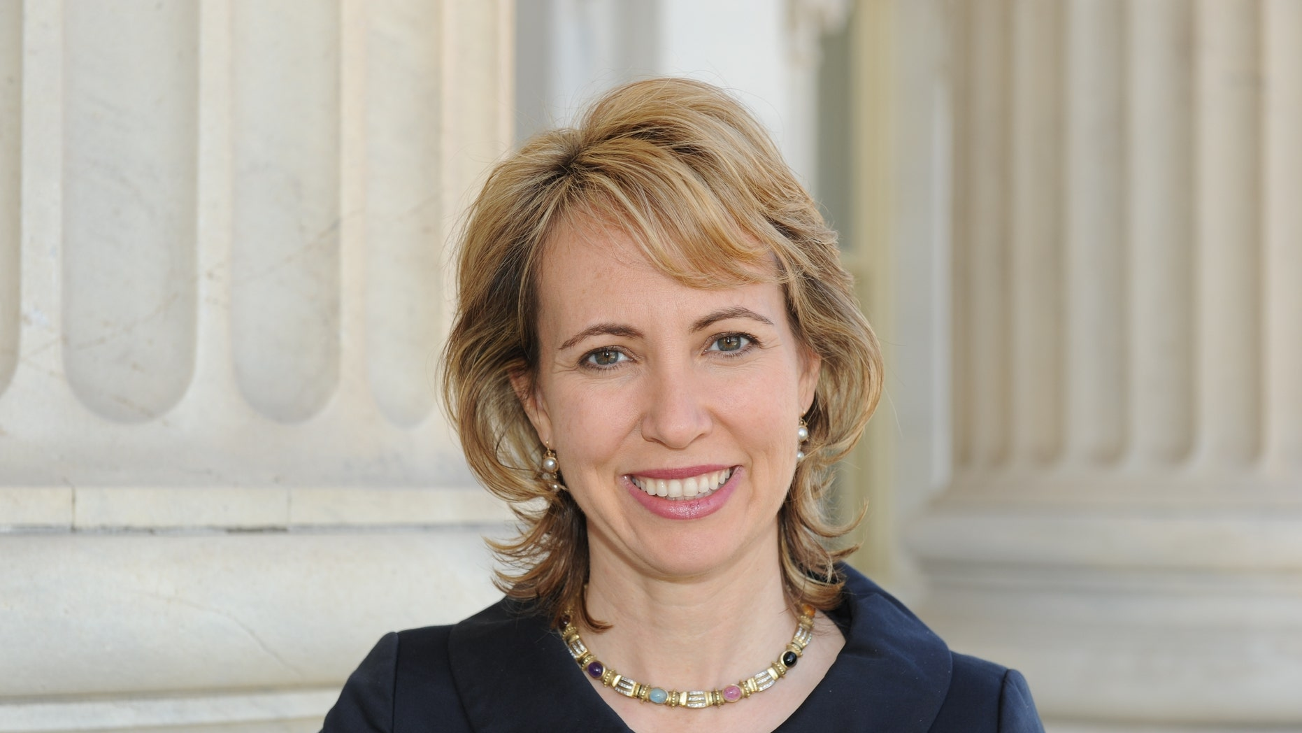 In this March, 2010 file photo, Rep. Gabrielle Giffords, Giffords poses for a photo. Giffords was critically wounded during a shooting at a political event Jan. 8 in Tucson, Ariz.