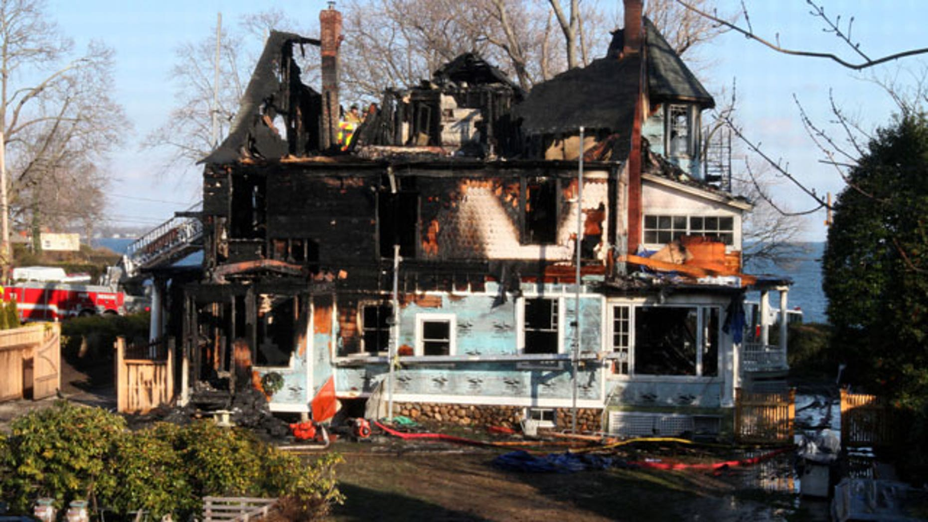 December 25, 2011: Firefighters investigate a house where an early morning fire left five people dead Sunday in Stamford, Conn.