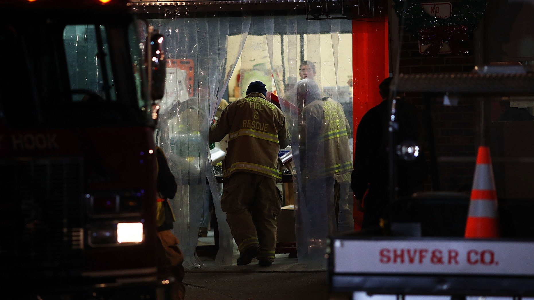 NEWTOWN, CT - DECEMBER 14:  A firefighter from the Sandy Hook Fire and Rescue walks into the firehouse near the Sandy Hook School on December 14, 2012 in Newtown, Connecticut. Twenty-seven are dead, including 20 children, after a gunman identified as Adam Lanza in news reports, opened fire in the school. Lanza also reportedly died at the scene. (Photo by Spencer Platt/Getty Images)
