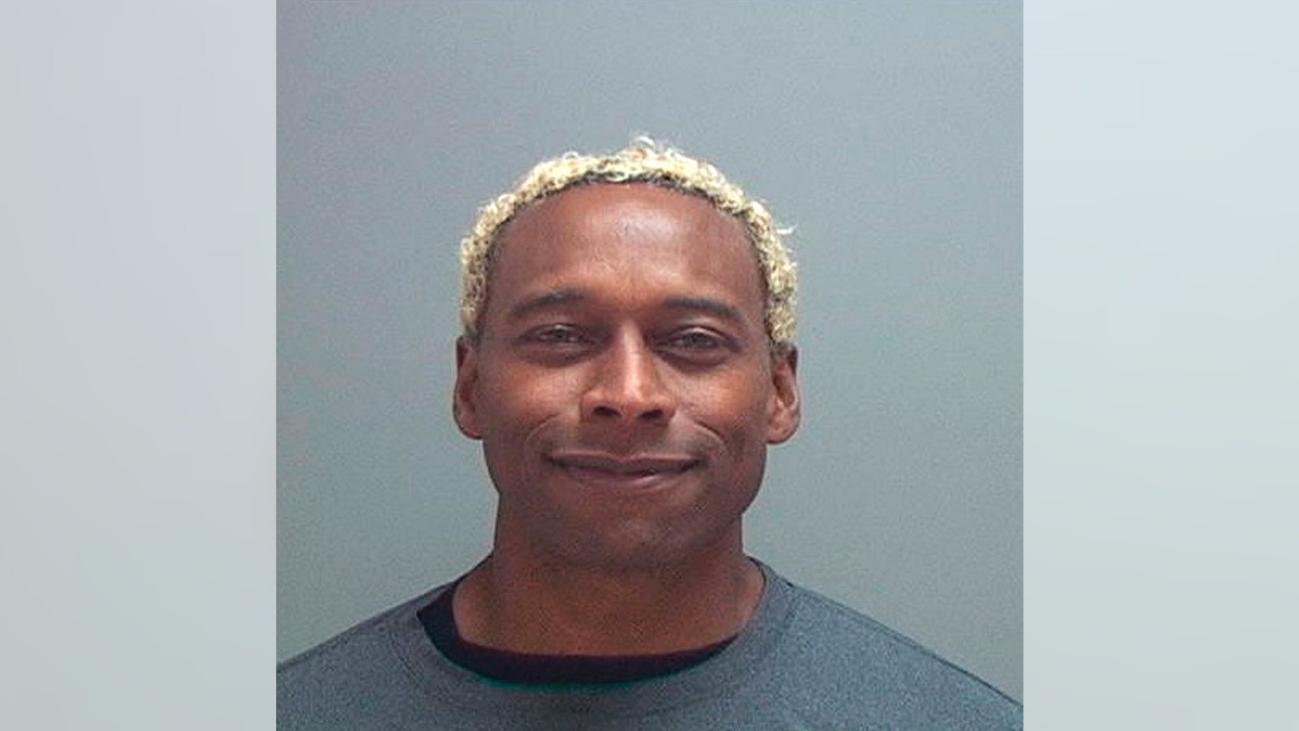 Anthony D. McClanahan, a former Canadian professional football player who trained with the Dallas Cowboys in the 1990s, was charged with killing his wife, prosecutors said on Monday.