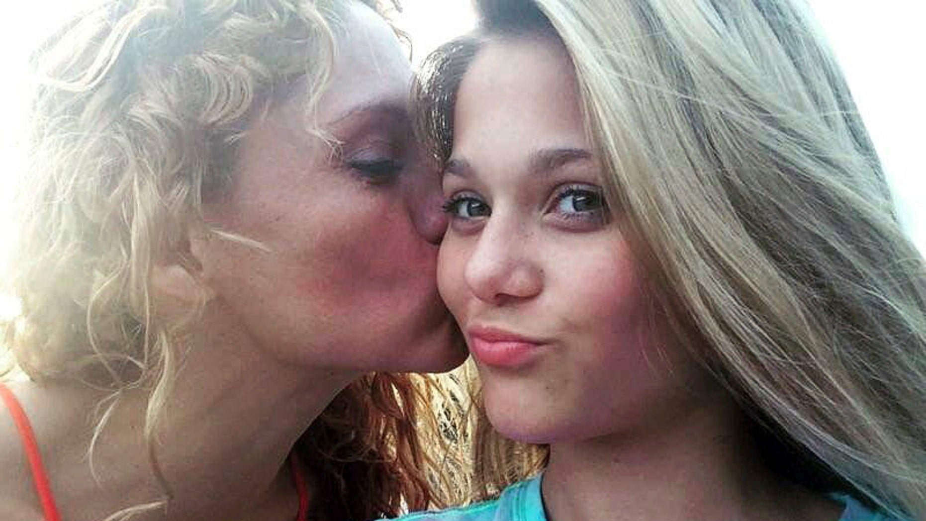 This undated photo shows Gabriella Green, 12, with her mother Tanya. Two 12-year-olds have been charged with cyberstalking in connection with Gabriella's death.
