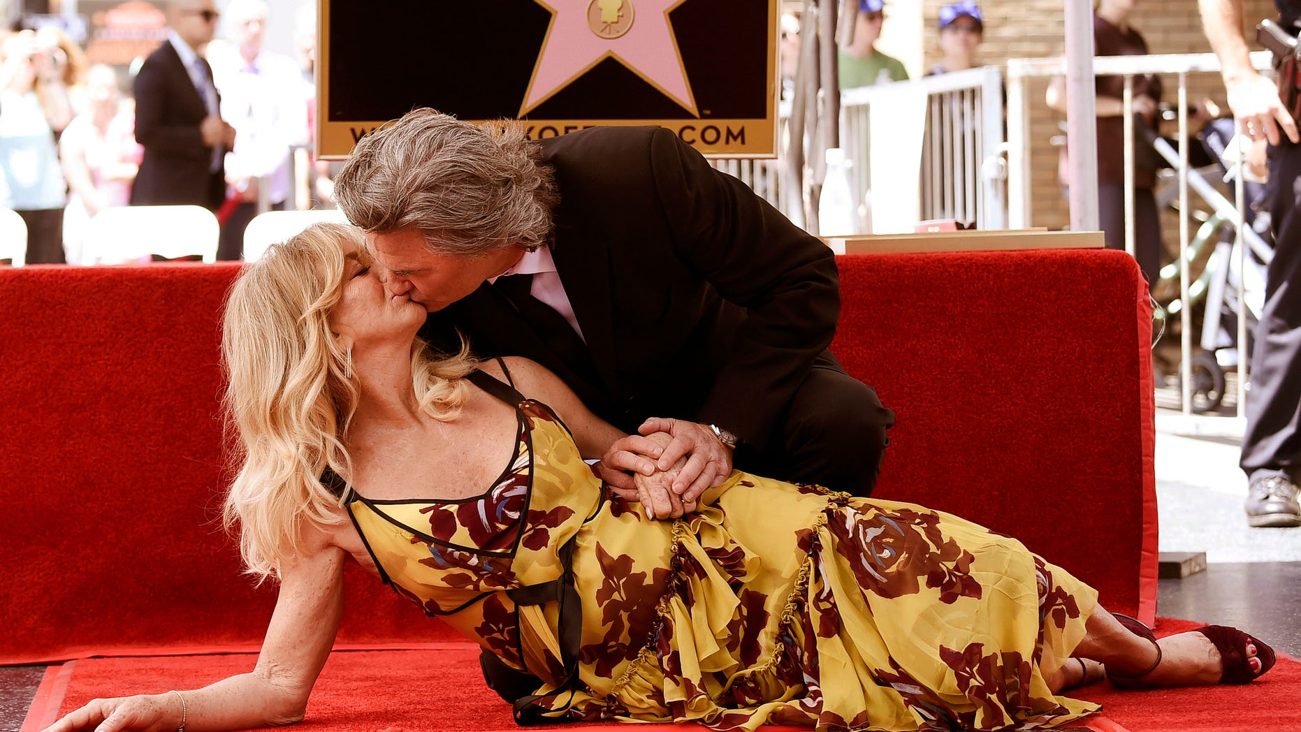 Goldie Hawn and Kurt Russell kiss at a ceremony honoring the couple each with stars on the Hollywood Walk of Fame on Thursday, May 4, 2017, in Los Angeles. (Photo by Richard Shotwell/Invision/AP