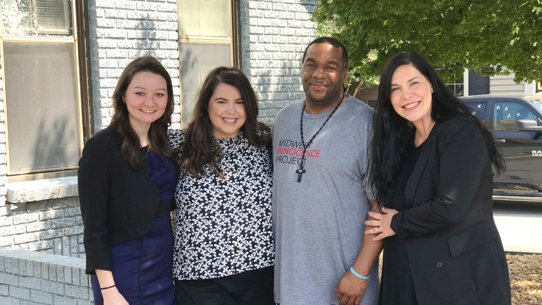In this photo provided by the law firm Lassiter and Cassinelli, John Brown, second from right, poses with Midwest Innocence Project investigator Blair Johnson, MIP attorney Rachel Wester, and attorney Erin Cassinelli after Brown was released from prison on Wednesday, Sept. 19, 2018, in Little Rock, Ark. In August, a judge overturned Brown's 1992 conviction for the murder and robbery of an elderly woman. The state is appealing the judge's decision and Brown could still be retried. (Jene Louviere/Lassiter and Cassinelli via AP)