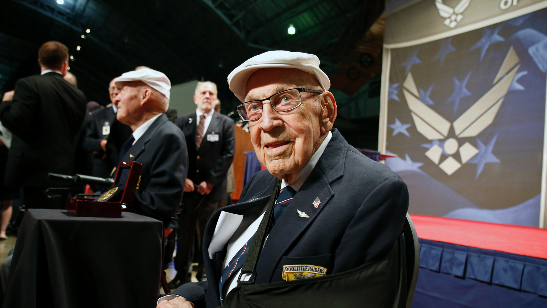 "FILE - In this April 18, 2015, file photo, two members of the Doolittle Tokyo Raiders, retired U.S. Air Force Lt. Col. Richard ""Dick"" Cole, seated front, and retired Staff Sgt. David Thatcher, seated left, pose for photos after the presentation of a Congressional Gold Medal honoring the Doolittle Tokyo Raiders at the National Museum of the U.S. Air Force at Wright-Patterson Air Force Base in Dayton, Ohio. The last surviving Doolittle Tokyo Raider is still telling his World War II stories, and he enjoys hearing new ones passed down to younger generations. (AP Photo/Gary Landers, File)"
