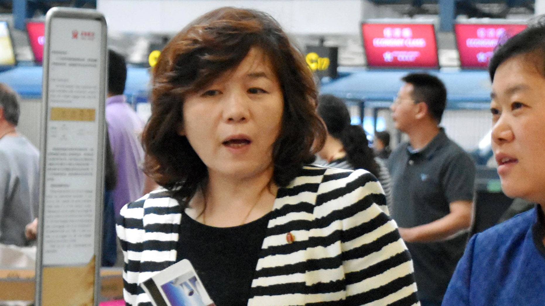 "Choi Sun-hee, left, the top North Korean diplomat who handles relations with the U.S. walks prior to her departure for Pyongyang, North Korea, at Beijing Capital International Airport in Beijing Saturday, May 13, 2017. Choi said Pyongyang would be willing to meet with the Trump administration for negotiations ""if the conditions are set,"" briefly to reporters en route to Pyongyang. She was traveling from Norway, where she led a delegation that held an informal meeting with U.S. experts. (Kyodo News via AP)"