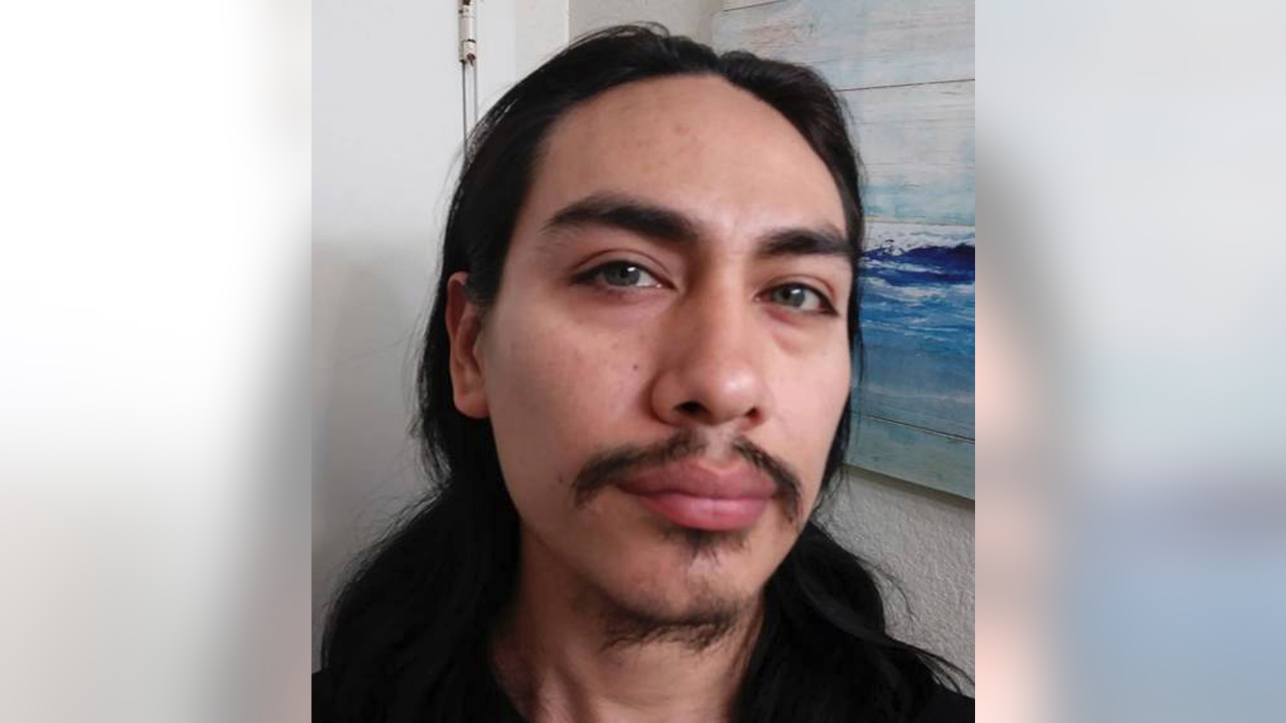 Police are searching for Jacob Gonzales, who they identified as a person of interest in the slaying of a 26-year-old woman found beheaded near a survivalist bunker on Saturday.