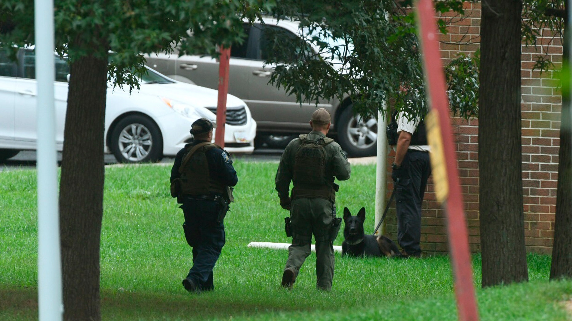 "Authorities respond to a shooting in Harford County, Md., Thursday, Sept. 20, 2018.   Authorities say multiple people have been shot in northeast Maryland in what the FBI is describing as an ""active shooter situation.""  (Jerry Jackson /The Baltimore Sun via AP)"