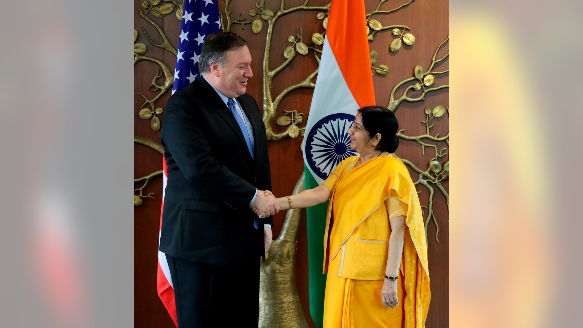 U.S. Secretary of State Mike Pompeo, left, shakes hand with Indian Foreign Minister Sushma Swaraj before a meeting in New Delhi, India, Thursday, Sept. 6, 2018. Pompeo and Defense Secretary James Mattis are holding long-delayed talks Thursday with top Indian officials, looking to shore up the alliance with one of Washington's top regional allies. (AP Photo/Manish Swarup)