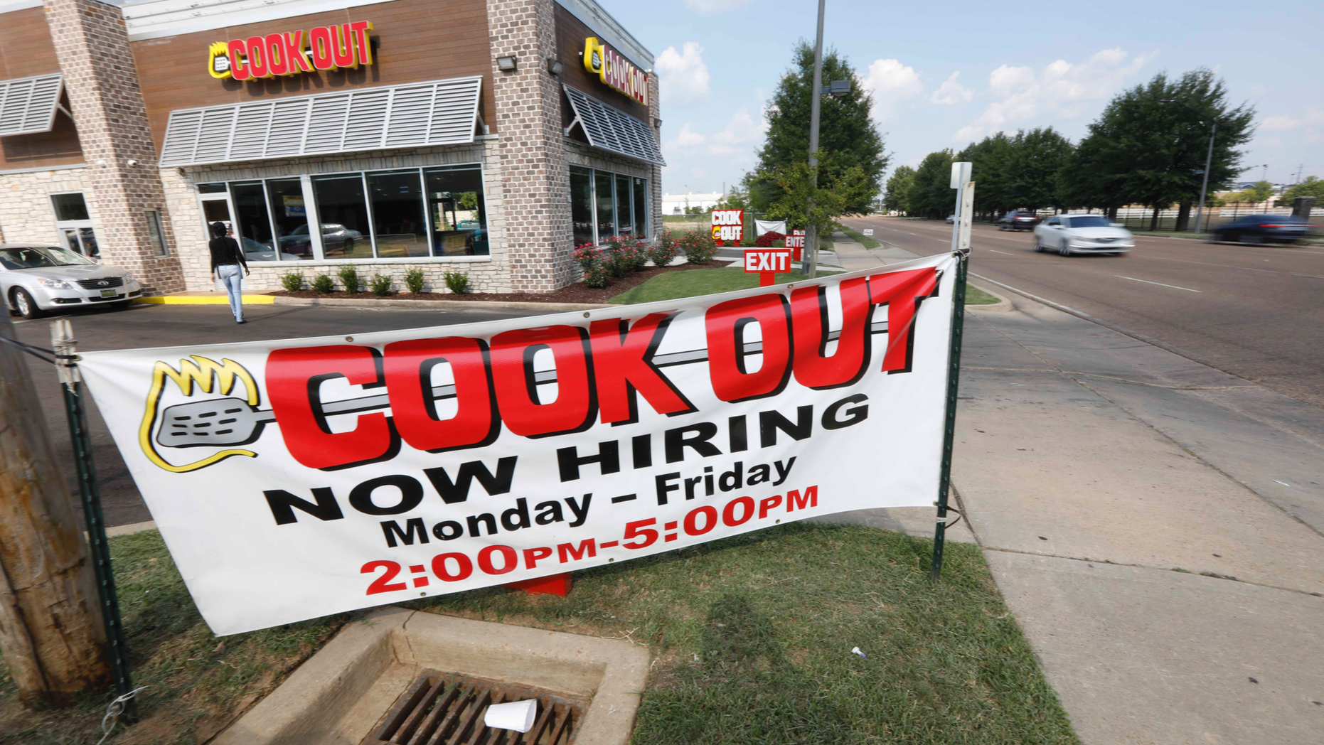 In this is a July 25, 2018, photo cars drive by a help wanted sign at a Cook Out fast food restaurant in Jackson, Miss. On Thursday, Sept. 6, payroll processor ADP reports how many jobs private employers added in August. (AP Photo/Rogelio V. Solis)