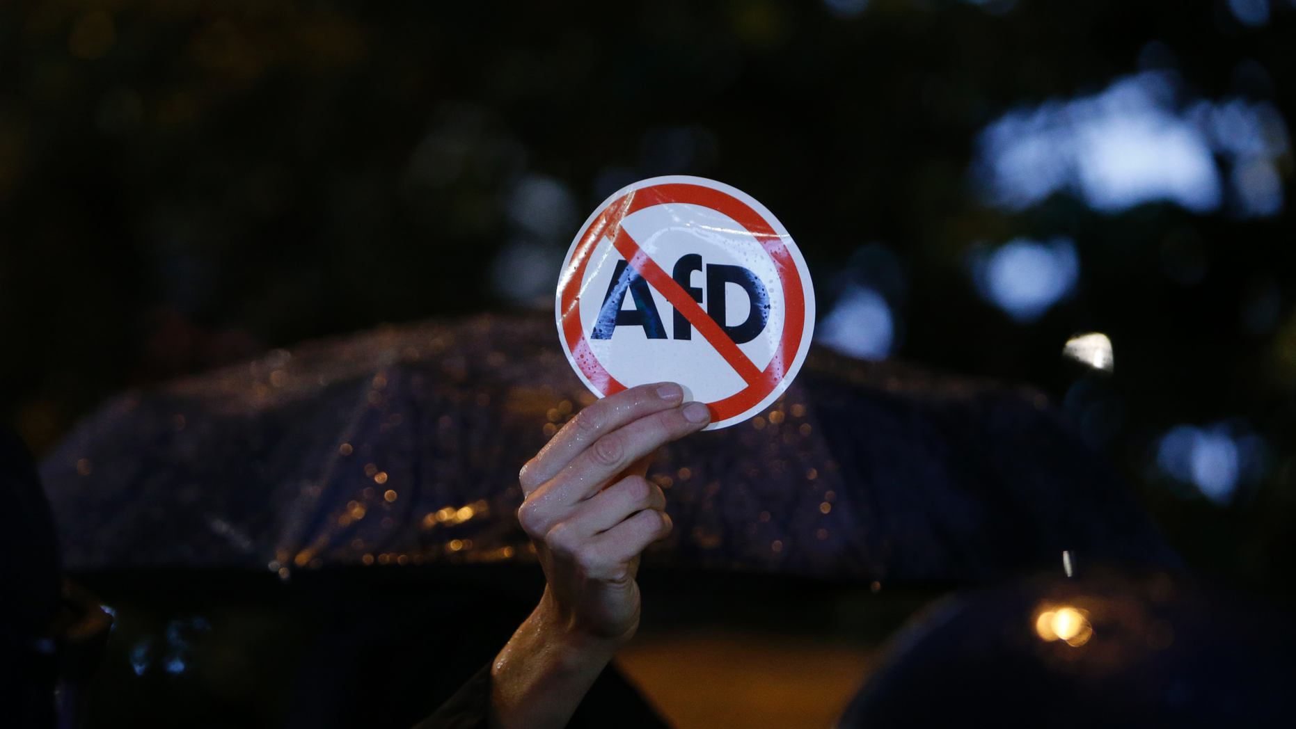 """FILE- In this Sept. 24, 2017 file photo police blocks demonstrators protesting against the nationalist 'Alternative for Germany', AfD, party in Berlin, Germany. A Jewish student group says it will protest the far-right Alternative for Germany's plans to found a Jewish section within party. Jewish Students Union of Germany leader Dalia Grinfeld said Wednesday the party, known as AfD, """"isn't getting a kosher certificate from us"""" because it is one of the biggest threats to Jewish life in Germany. (AP Photo/Michael Probst)"""