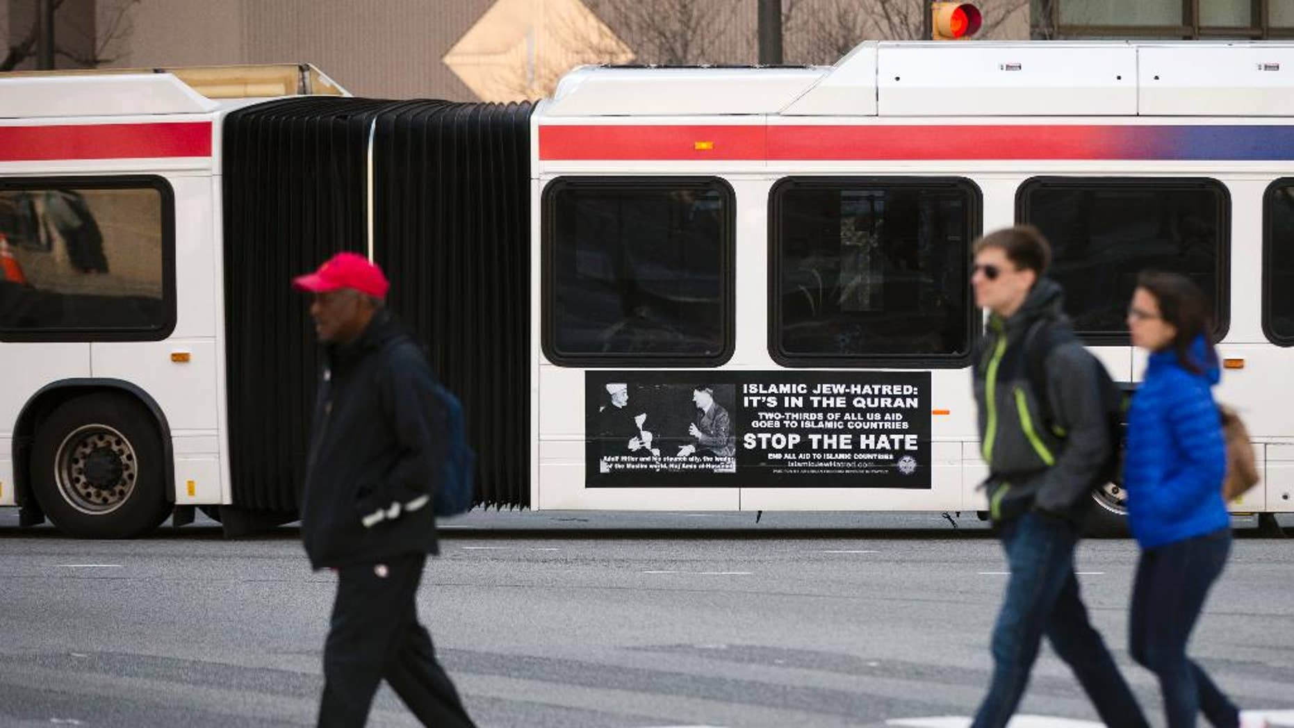 An ad from the pro-Israel American Freedom Defense Initiative is seen on an articulated Southeastern Pennsylvania Transportation Authority (SEPTA) bus featuring a 1941 photograph of Hitler and supporter Hajj Amin al-Husseini, a Palestinian Arab nationalist, Wednesday, April 1, 2015, in Philadelphia. A federal judge last month ordered SEPTA to accept the ads. The agency said last week it wouldn't appeal. (AP Photo/Matt Rourke)