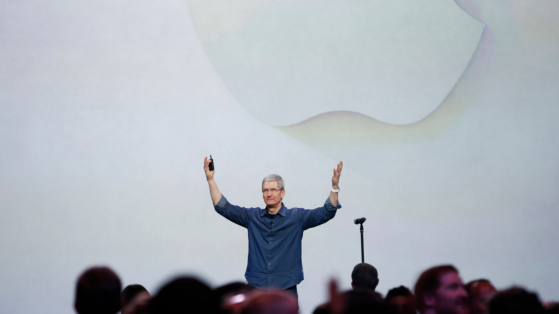 Apple CEO Tim Cook greets the audience during an Apple event announcing the iPhone 6 and the Apple Watch.
