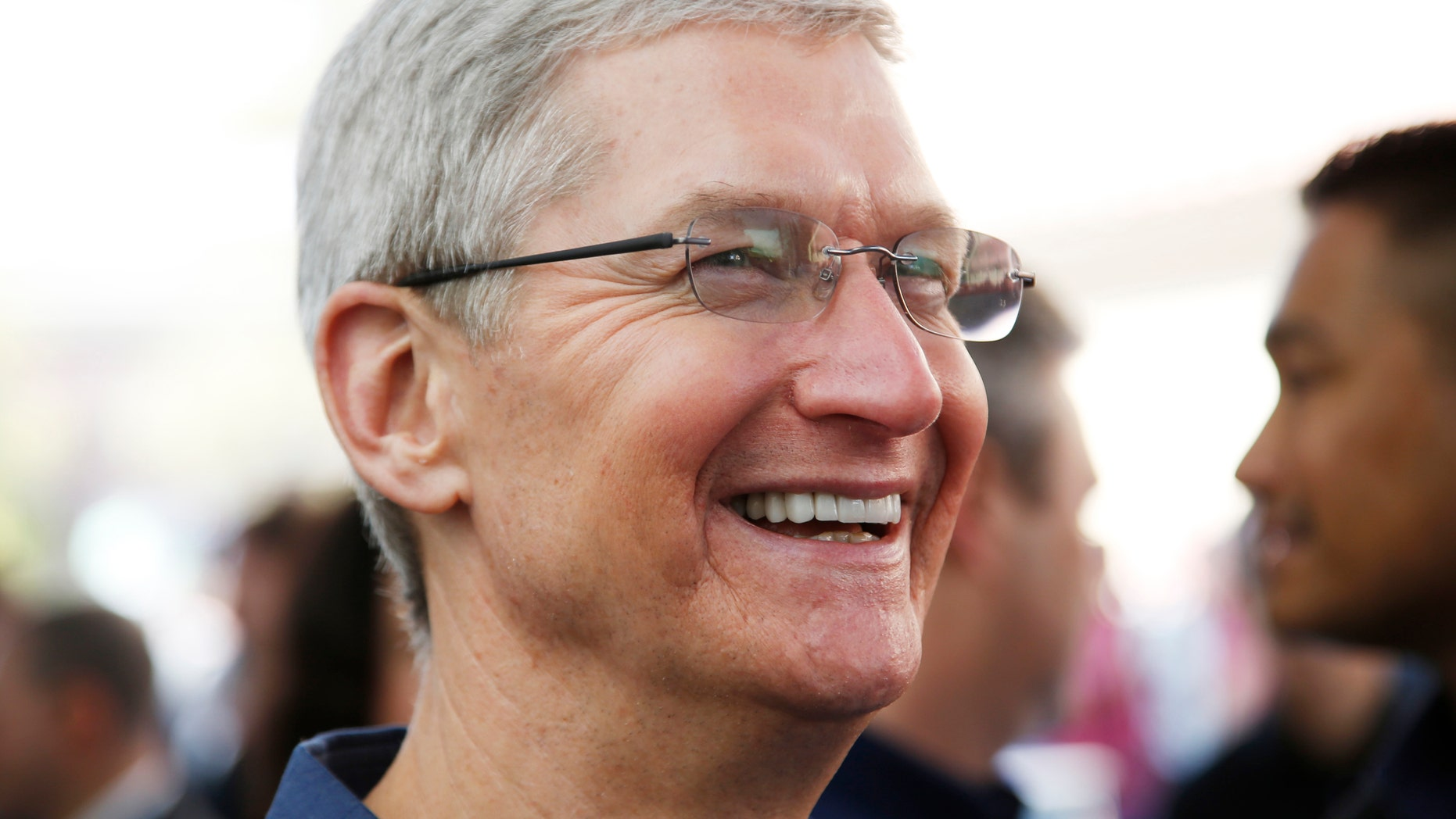 Apple CEO Tim Cook speaks to members of the media during an Apple event announcing the iPhone 6 and the Apple Watch at the Flint Center in Cupertino, California, September 9, 2014. REUTERS/Stephen Lam (United States - Tags: SCIENCE TECHNOLOGY BUSINESS) - RTR45L7U