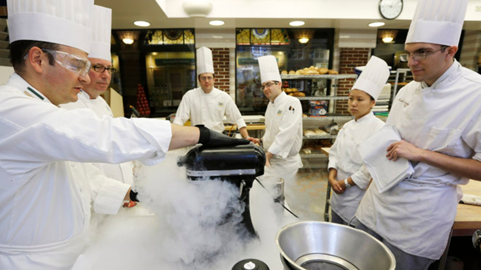Sept. 14, 2012: Chef Francisco Migoya, left, demonstrates how to make strawberry sorbet by applying liquid nitrogen to a puree mixture.